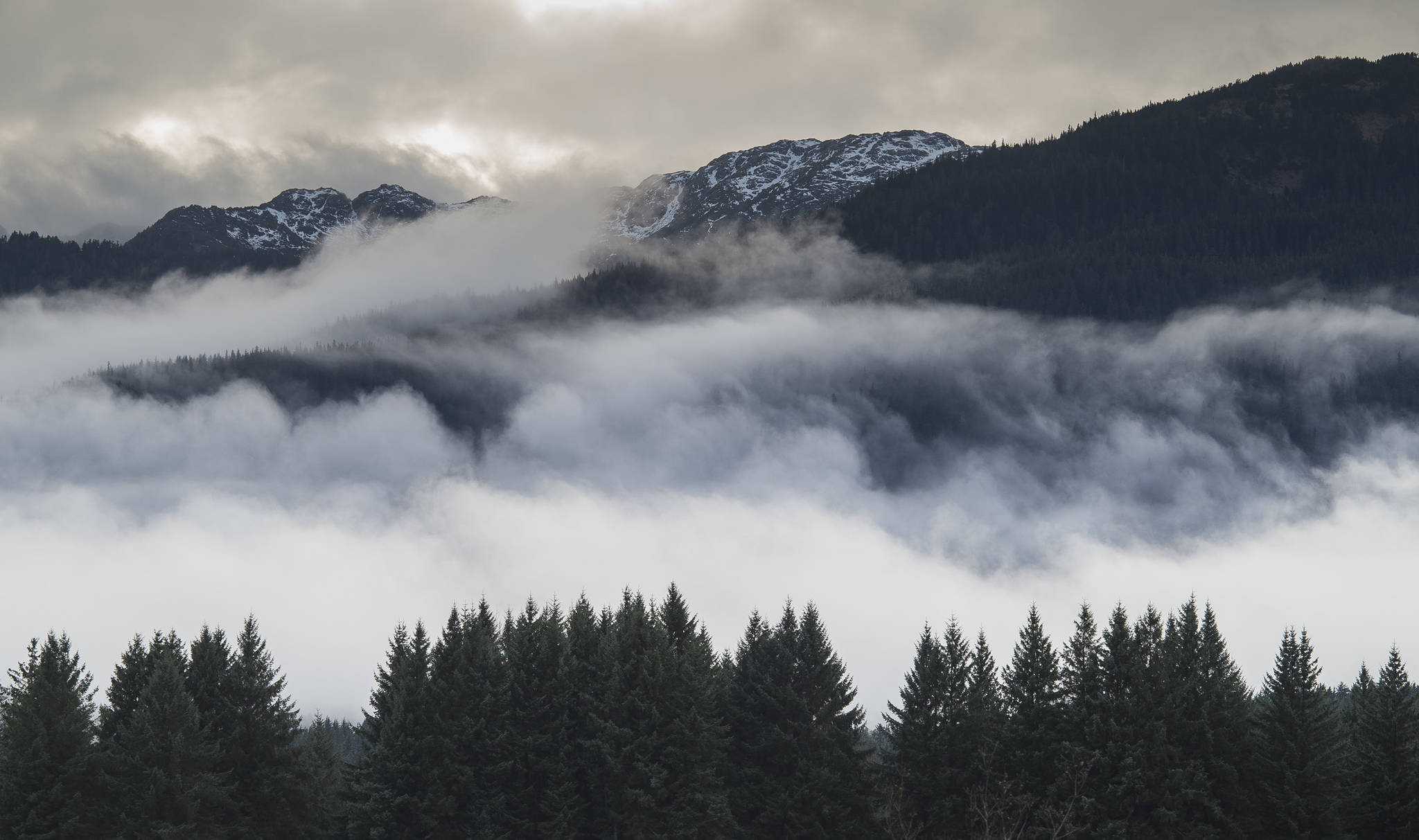 In this Nov. 29, 2018 photo, clouds swirl over Douglas Island. (Michael Penn | Juneau Empire File)