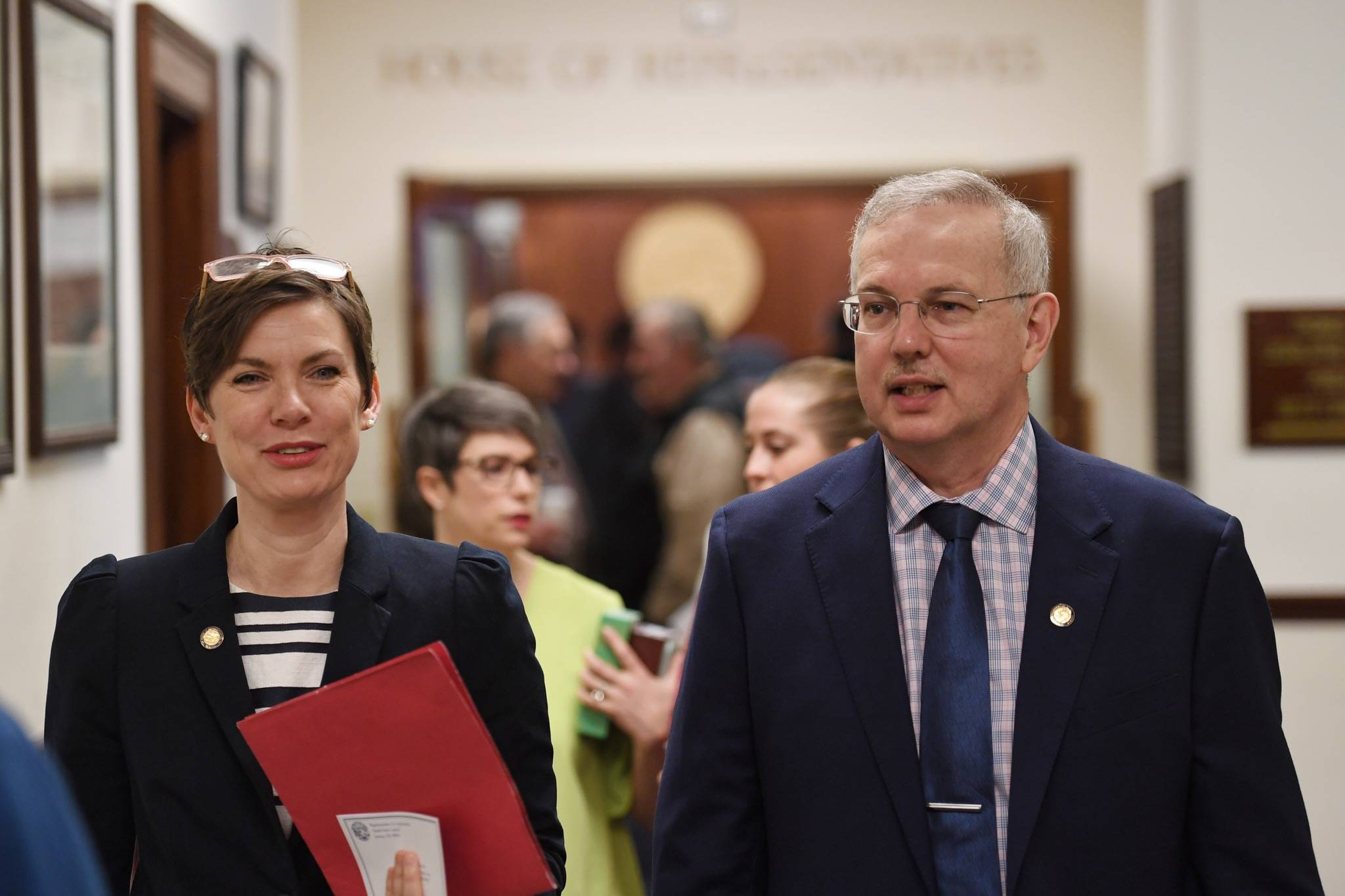 Rep. Ivy Spohnholz, D-Anchorage, walks with Speaker of the House Bryce Edgmon, I-Dillingham, as the House takes an at ease to wait for the conference committee on the crime bill to take place at the Capitol on Thursday, May 16, 2019. (Michael Penn | Juneau Empire)