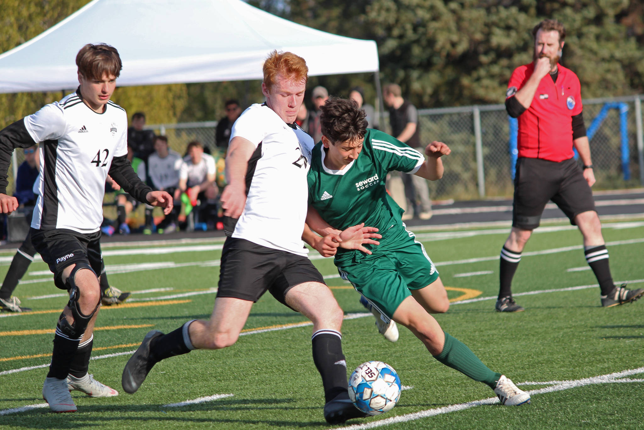 Nikiski's Jace Kornstad (left) and Seward's John Moriarty (right) battle for the ball during the first boys game of the Peninsula Conference Soccer Tournament held Thursday, May 16, 2019 at Homer High School in Homer, Alaska. (Photo by Megan Pacer/Homer News)