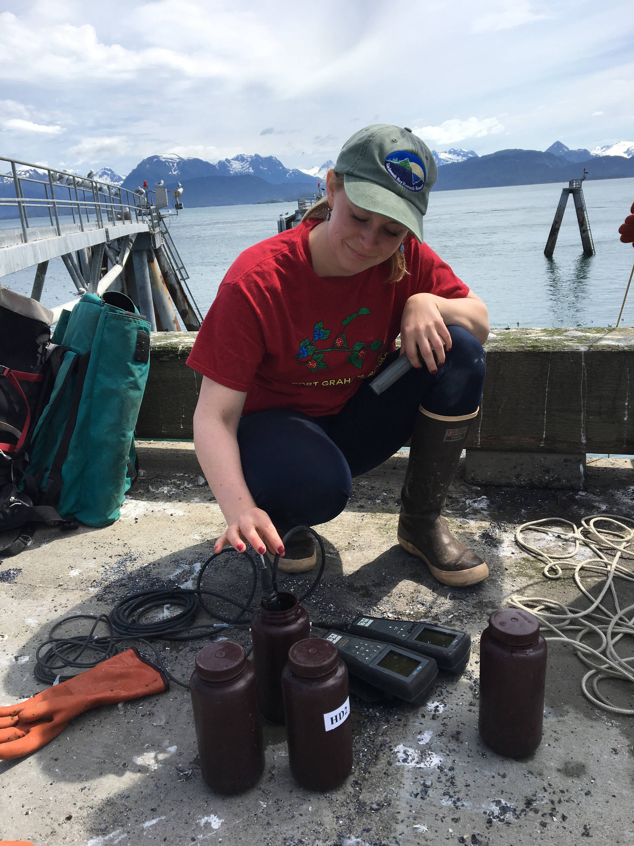 Harmful species coordinator Rosie Masui takes samples at the Homer Harbor in July 2017 in Homer, Alaska. (Photo provided)