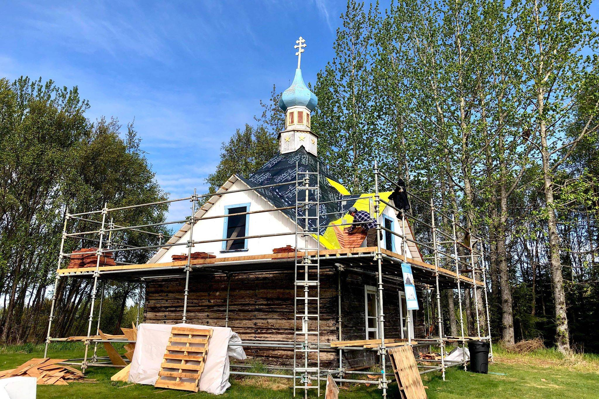 John Wachtel, a former National Parks Service employee, places new cedar shingles on the roof of the Saint Nicholas Memorial Chapel as part of new restorative efforts, on Tuesday, May 21, 2019, in Old Town Kenai, Alaska. (Photo by Victoria Petersen/Peninsula Clarion)