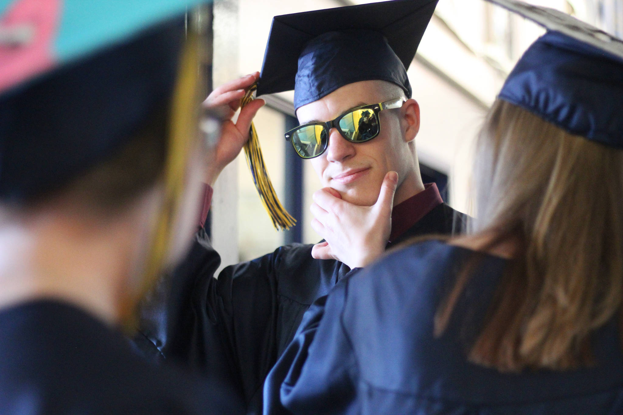 Isabella Koch helps Garrett Koch perfect the finishing touches before they walk in their graduation ceremony Tuesday, May 21, 2019 at Ninilchik School in Ninilchik, Alaska. They are two of four total Ninilchik graduates this year. (Photo by Megan Pacer/Homer News)