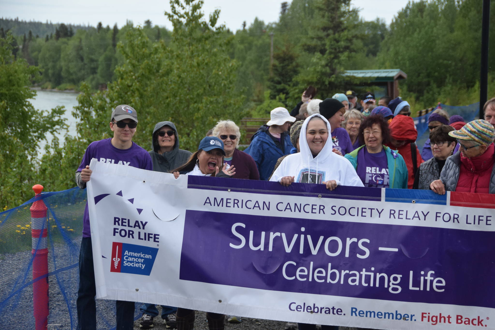Participants at the 2019 Relay for Life of the Kenai Peninsula line up at Soldotna Creek Park on June 1, 2019 to start the survivor's walk, which is designated for cancer survivors and their caretakers. All those wearing purple shirts are cancer survivors, including Joseph Yourkoski, far left, a 17 year old at Nikiski High School. Eighteen teams raised over $25,000 at this year's event, which featured live entertainment, face painting and a pancake eating contest. (Photo by Brian Mazurek/Peninsula Clarion)