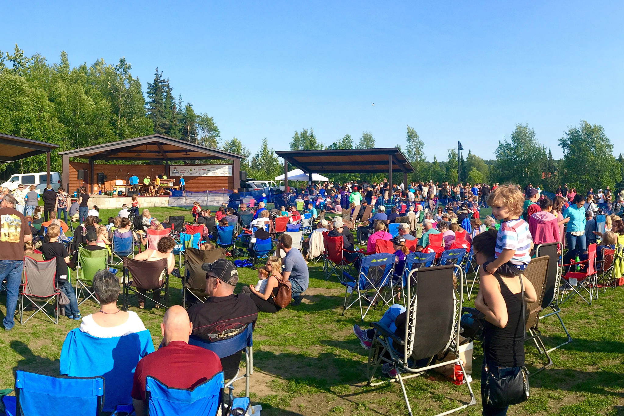 Concertgoers listen during one of the weekly concerts in the park, put on as part of the Levitt AMP Soldotna Music Series in Soldotna, Alaska, in the summer of 2017. (Photo courtesy Andrew Heuiser/Soldotna Chamber of Commerce)