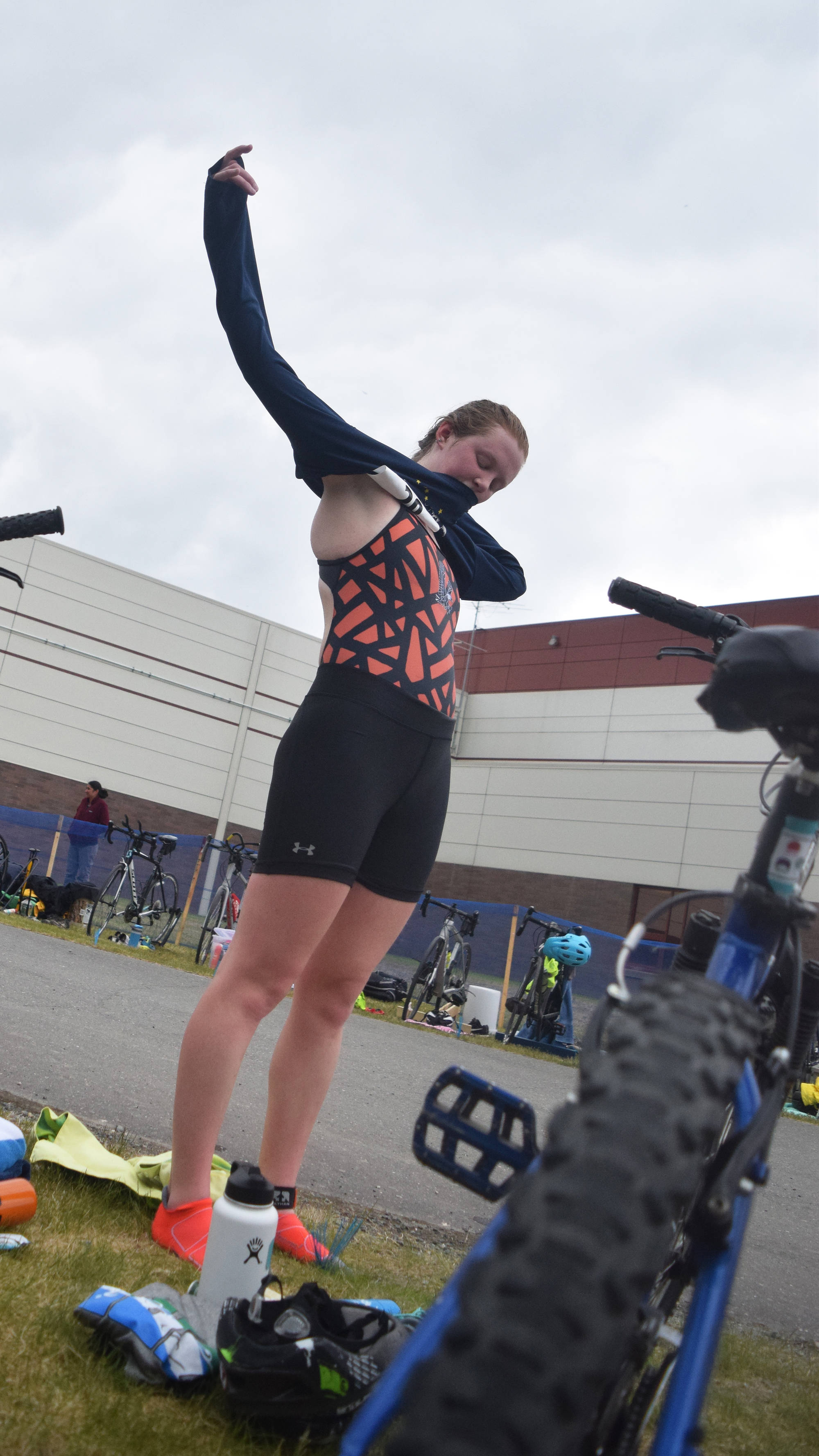 Anchorage's Afton Milliman changes clothes as she prepares for the cycling leg Sunday, June 9, 2019, in the Tri-The-Kenai Triathlon in Soldotna, Alaska. (Photo by Joey Klecka/Peninsula Clarion)