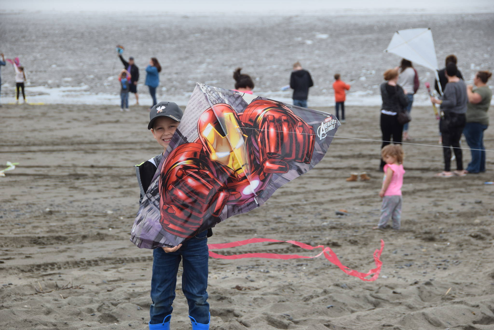Jasper Webb from Kenai shows off his Iron Man kite during the first Kenai Kite Festival on the Kenai North Beach in Alaska on Saturday, June 15, 2019. (Photo by Brian Mazurek/Peninsula Clarion)
