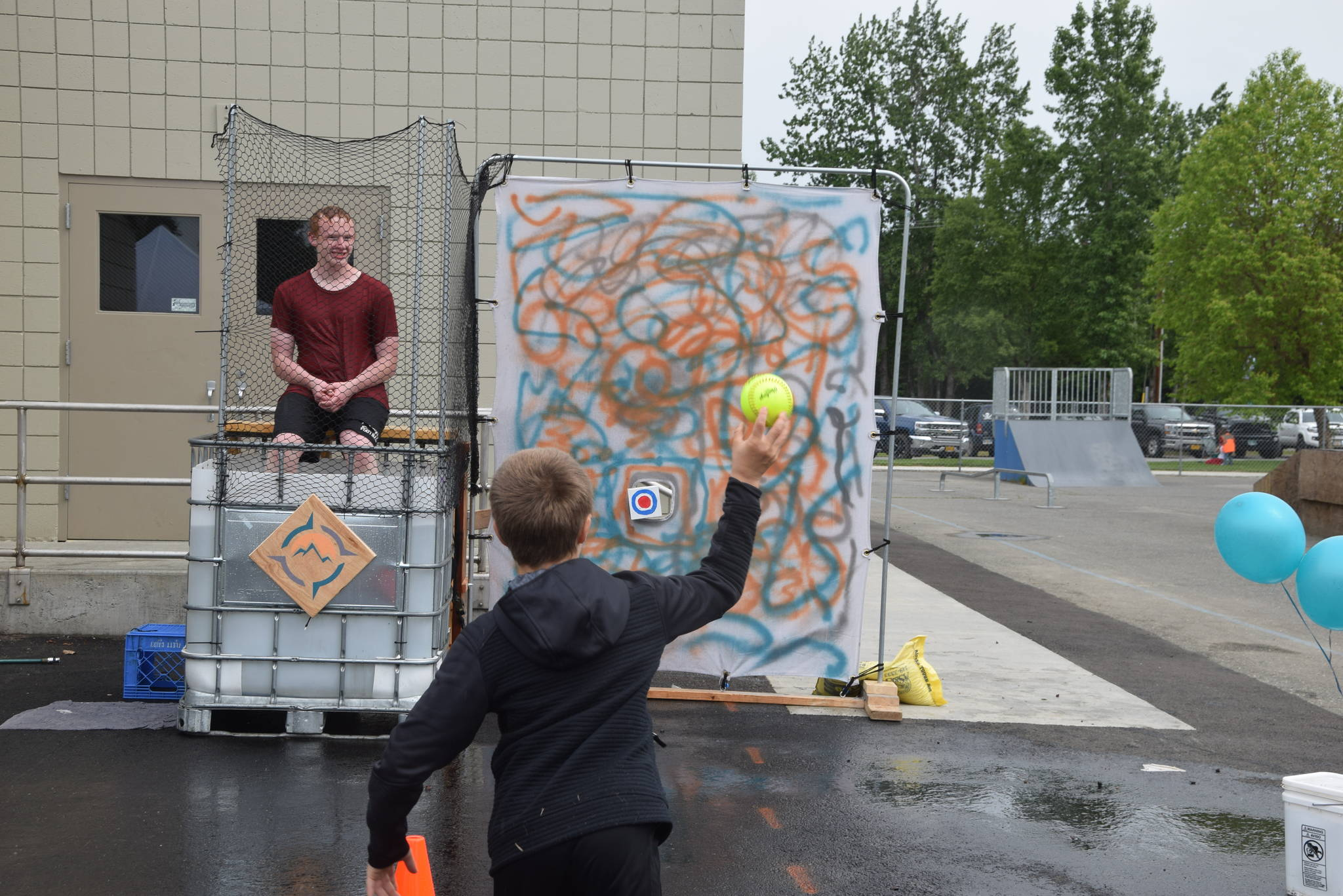 A boy tries his hand at the Compass Dunk Tank during the Family Fun in the Midnight Sun festival at the North Peninsula Recreation Center in Nikiski, Alaska on June 15, 2019. (Photo by Brian Mazurek/Peninsula Clarion)