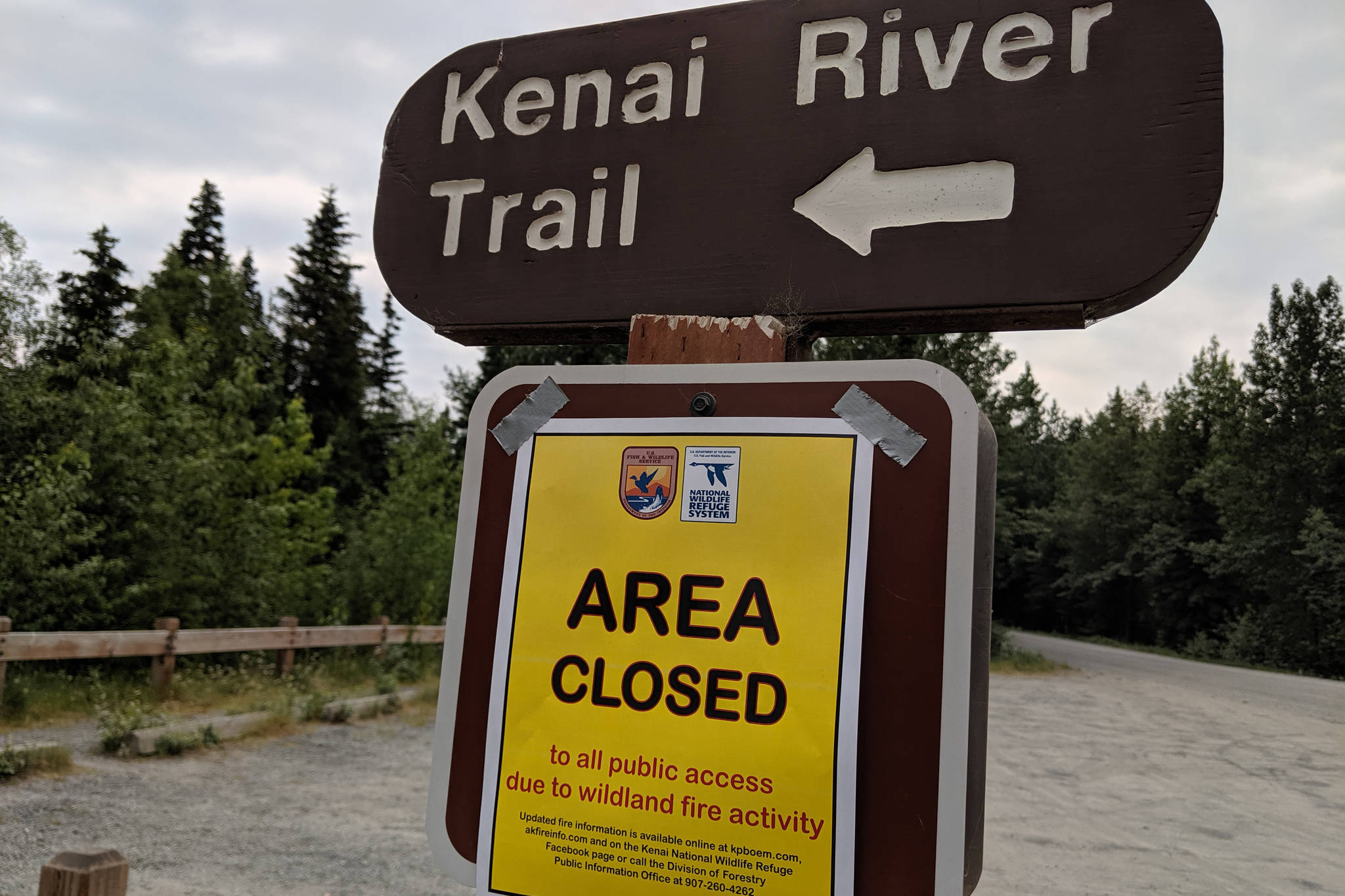 A sign for trail closures can be seen on Skilak Lake Road on Sunday, June 23, 2019. The Kenai Wildlife Refuge closed recreation areas, including Bottenintnin Lake, Watson Lake Campground, Egumen Lake Trail, Petersen Lake Campground, Kelly Campground, Seven Lakes Trail, Skyline Trail and Jean Lake Campground over the weekend. (Photo by Erin Thompson/Peninsula Clarion)