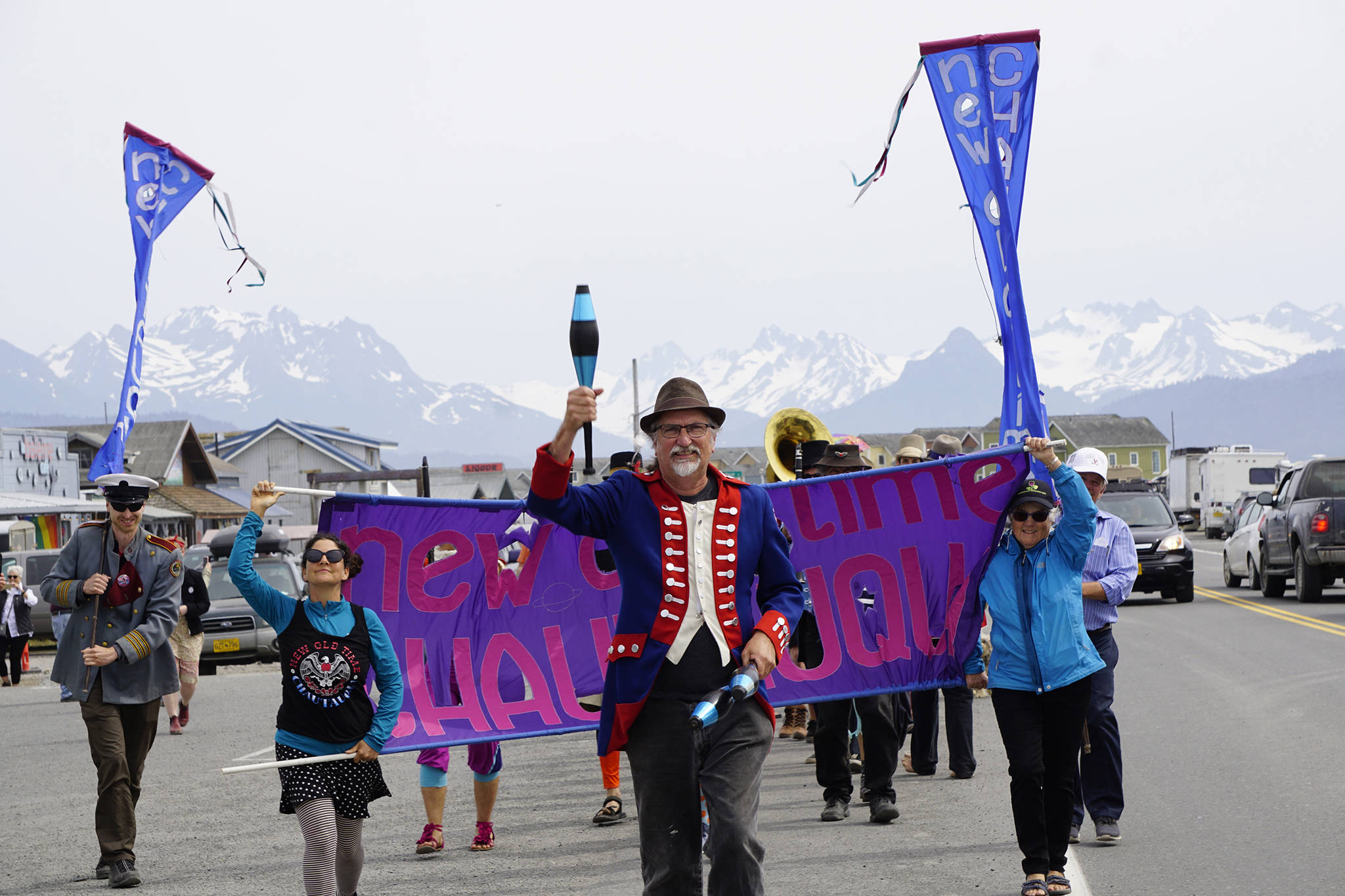 The New Old Time Chautauqua Fighting Instruments of Karma Marching Chamber Band Orchestra marches on the Homer Spit on July 2, 2019, in Homer, Alaska. The group visited Homer as part of a week-long tour partially funded by the Rasmuson Foundation's Harper Arts Touring Fund, administered by the Alaska State Council on the Arts — an example of state-foundation cooperation in arts funding. (Photo by Michael Armstrong/Homer News)