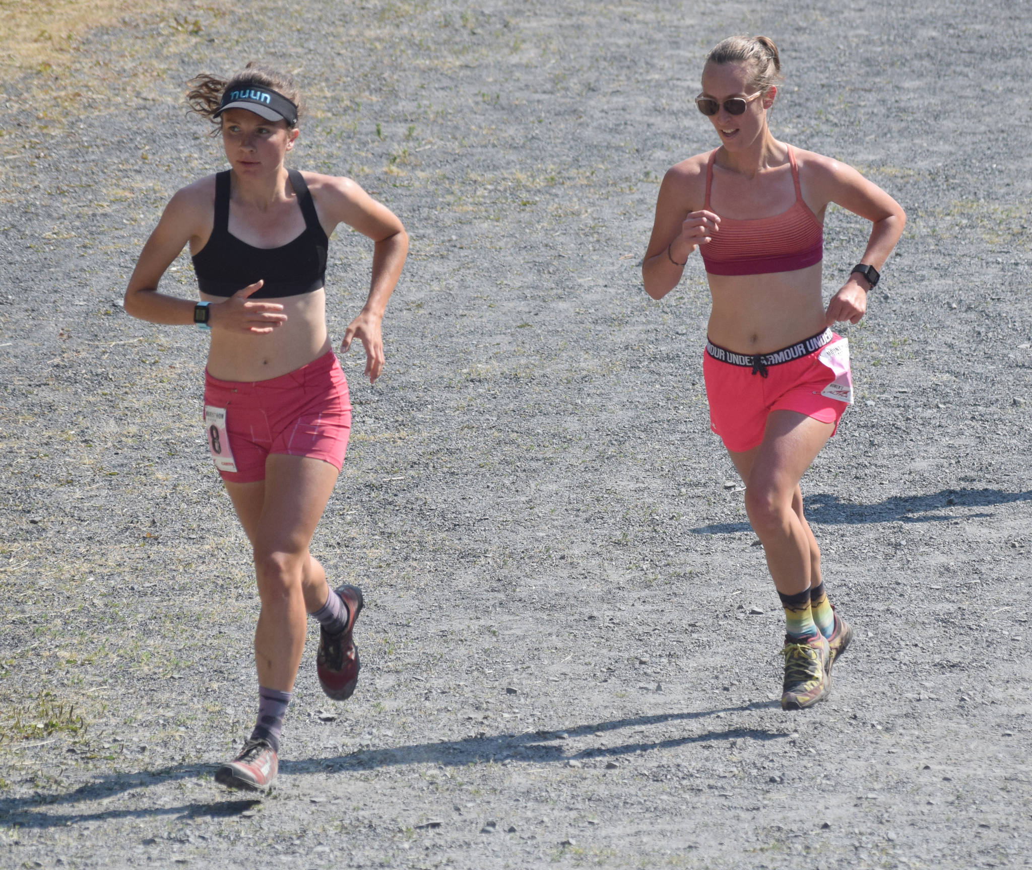 Abby Jahn of Anchorage and Allison Barnwell of Seward approach the mountain during the women's Mount Marathon Race on Thursday, July 4, 2019, in Seward, Alaska. (Photo by Jeff Helminiak/Peninsula Clarion)