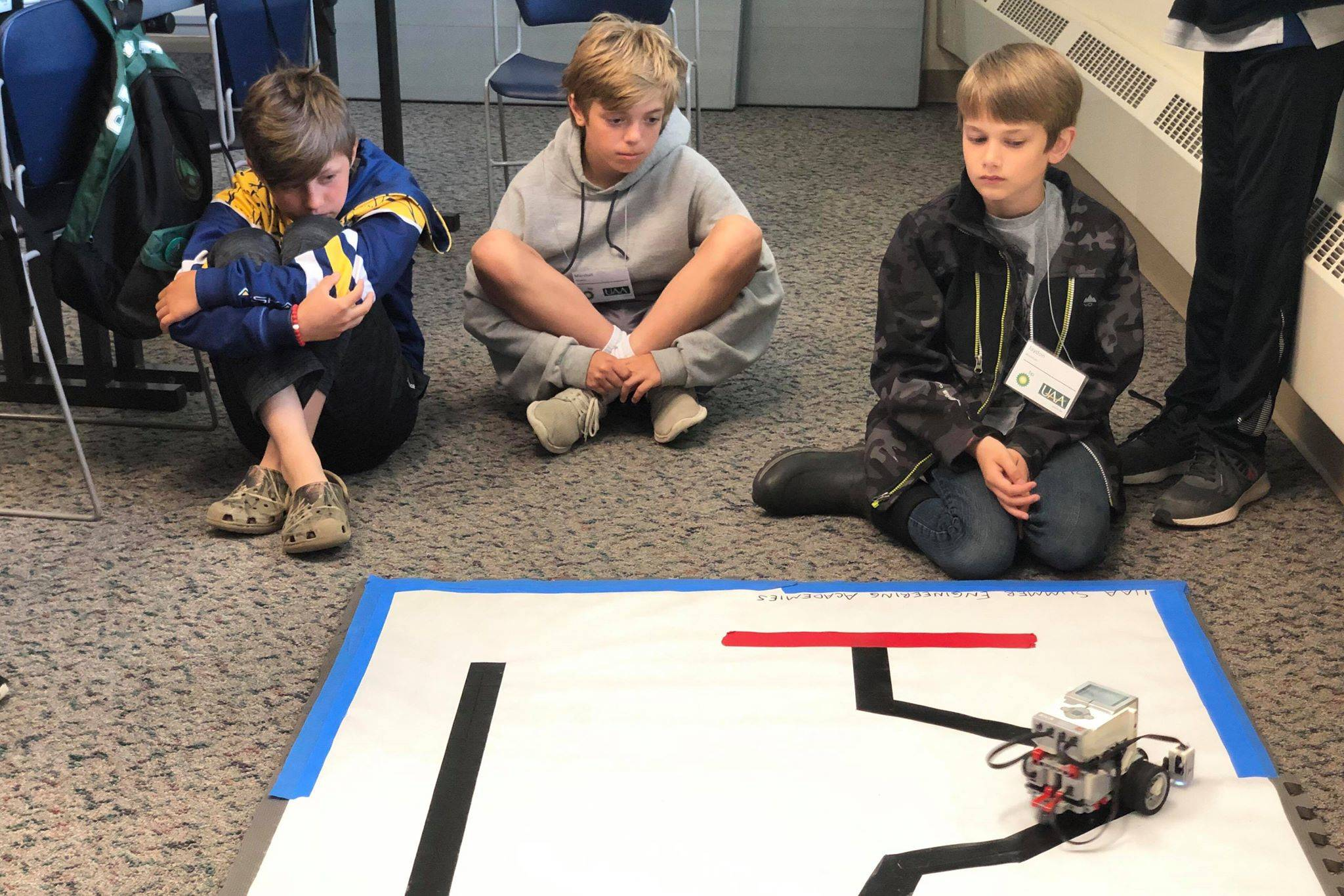 Students put their robot to the test in one of the many challenges in the Lego robotics UAA College of Engineering Summer Engineering Academies, on Wednesday, June 26, 2019, at the Kenai Peninsula College near Soldotna, Alaska. (Photo by Victoria Petersen/Peninsula Clarion)