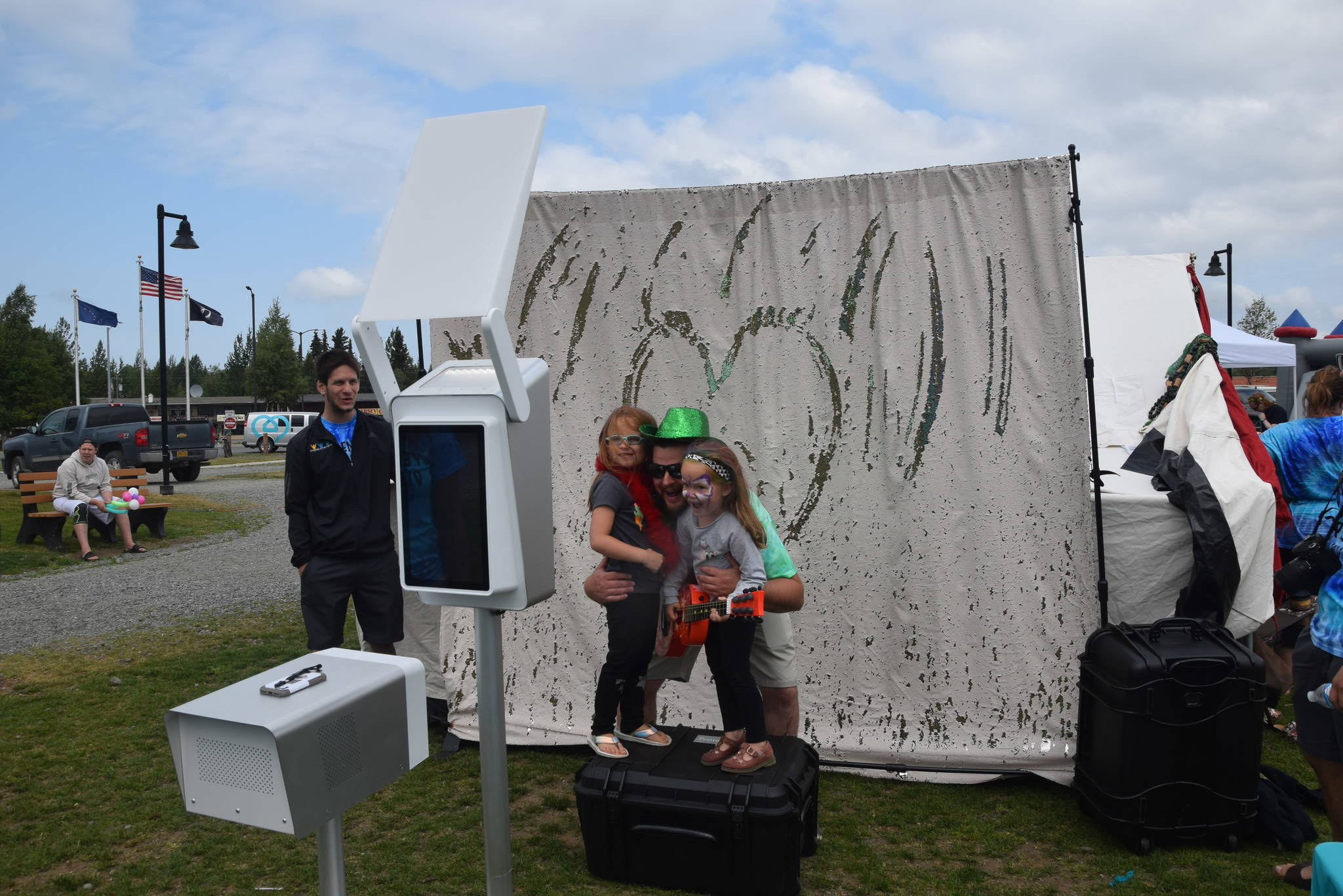 Chris Finley and his daughters Aubree and Danni pose at the photo booth during the 2019 Disability Pride Celebration in Soldotna Creek Park on July 20, 2019. (Photo by Brian Mazurek/Peninsula Clarion)
