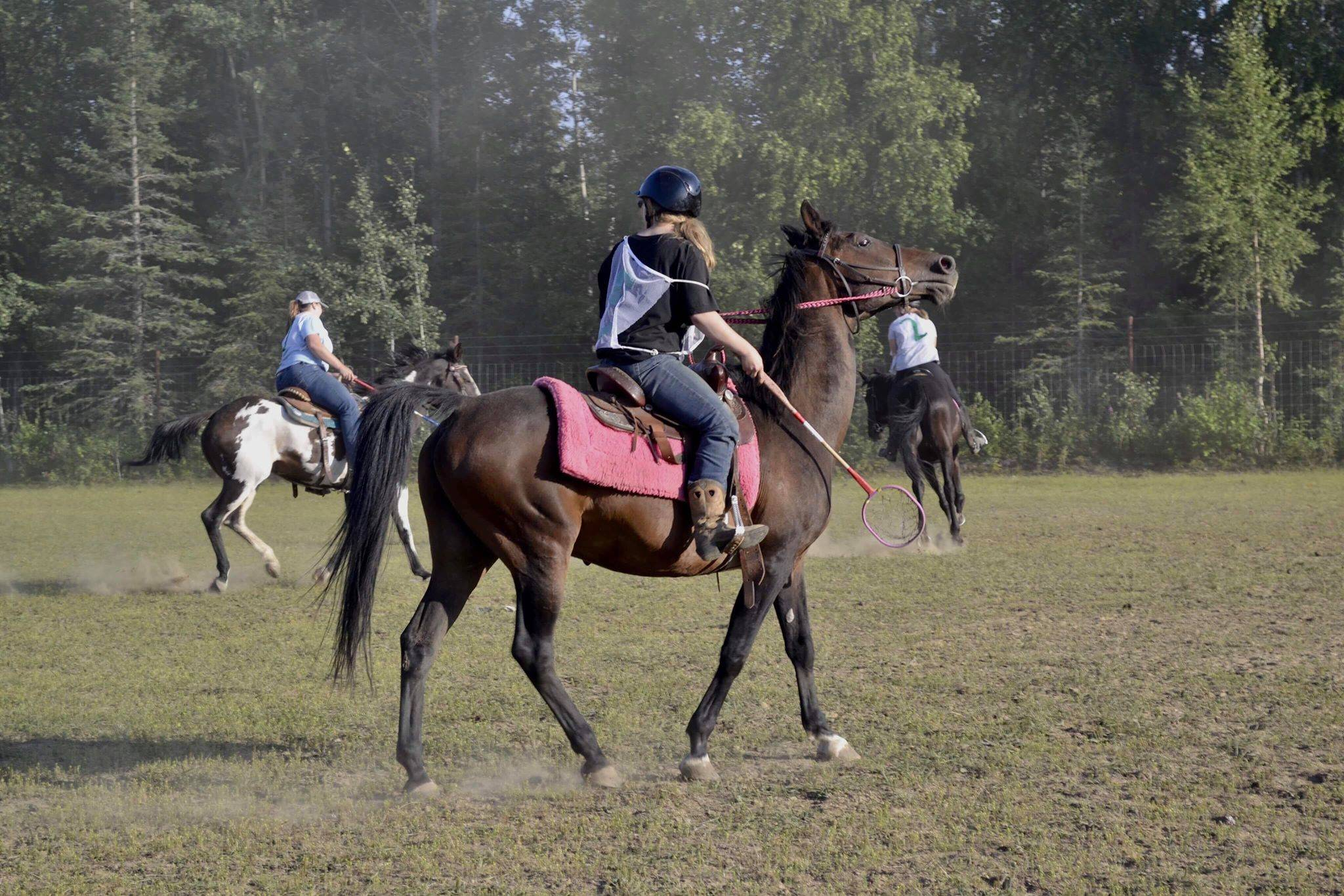 Maya Johnson, the Kenai polocrosse organizer, rides her horse during a game of polocrosse, a sport combining rules of polo and lacrosse, Thursday, July, 25, 2019 near Soldotna, Alaska. (Photo by Victoria Petersen/Peninsula Clarion)