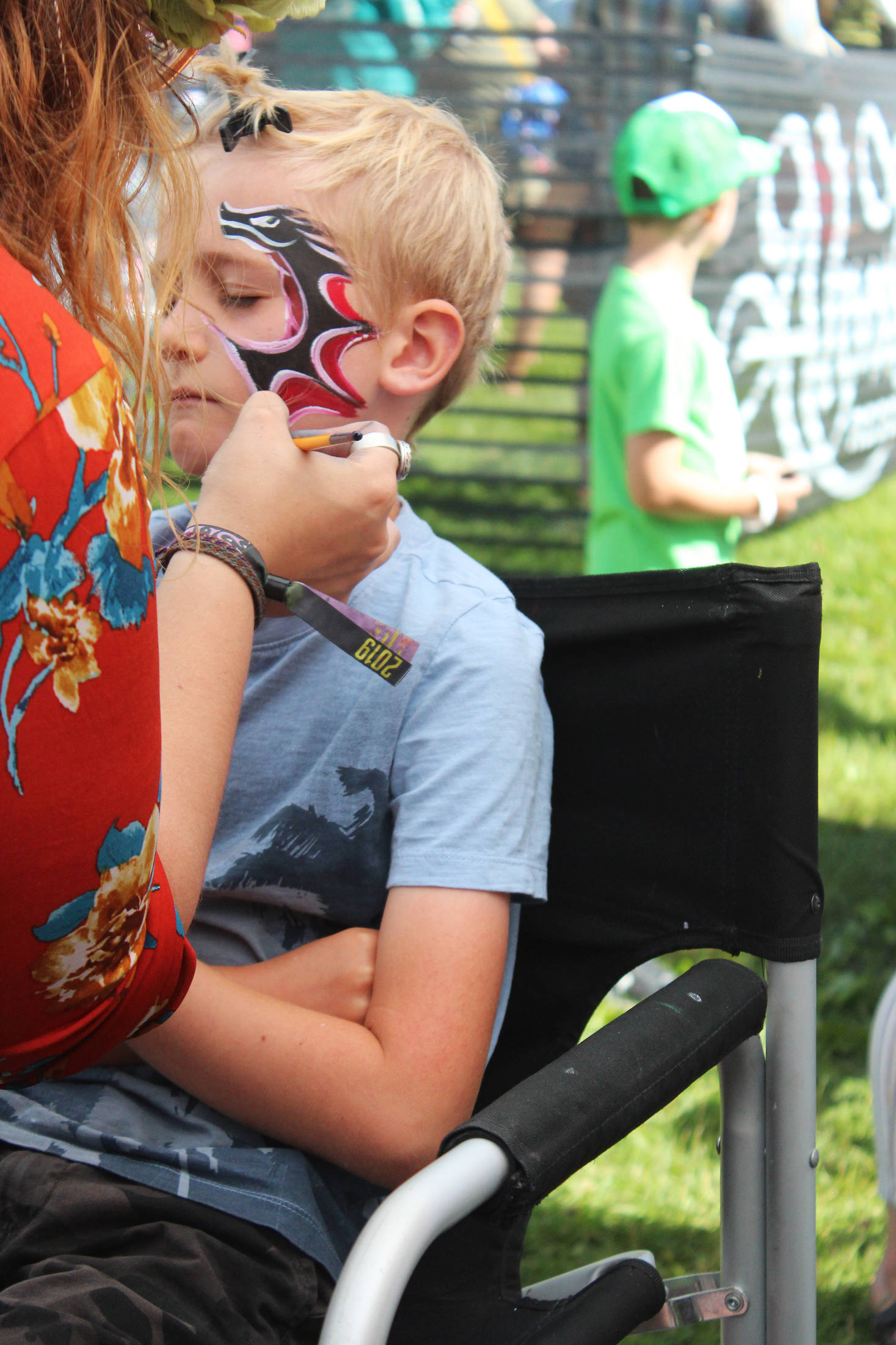 Photo by Megan Pacer / Homer News                                 Iver Ledahl, 8, of Kenai, gets his face painted Friday at Salmonfest.