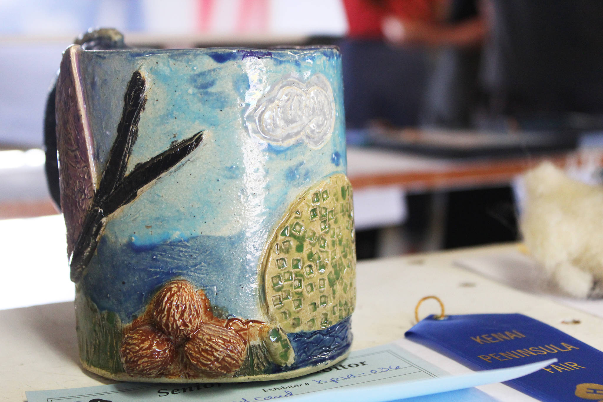 A ceramic mug created by a fair participant rests on a shelf in the exhibit hall Friday, Aug. 16, 2019 at the Kenai Peninsula Fair in Ninilchik, Alaska. (Photo by Megan Pacer/Homer News)