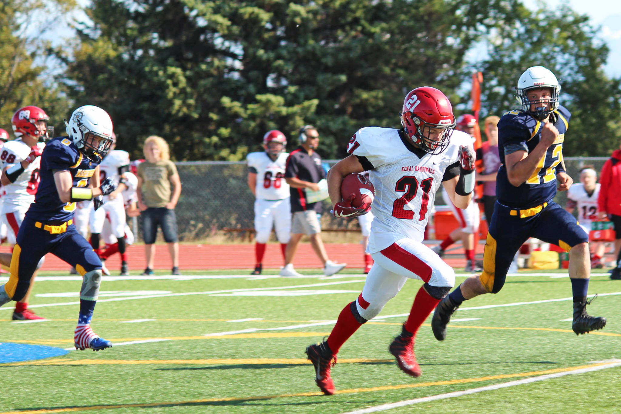 Kenai Central High School senior Zach Burnett breaks away from the Homer defense to make a 62-yard run and touchdown for the Kardinals during a Saturday, Aug. 17, 2019 football game at the Mariner field in Homer, Alaska. (Photo by Megan Pacer/Homer News)
