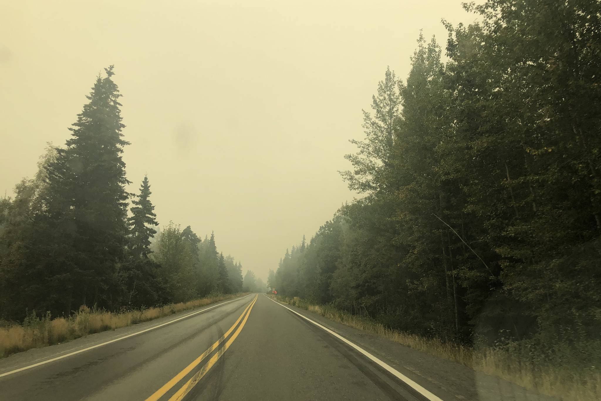 Smoke from the Swan Lake Fire impairs visibility on the Sterling Highway on Aug. 20, 2019. (Photo by Victoria Petersen/Peninsula Clarion)
