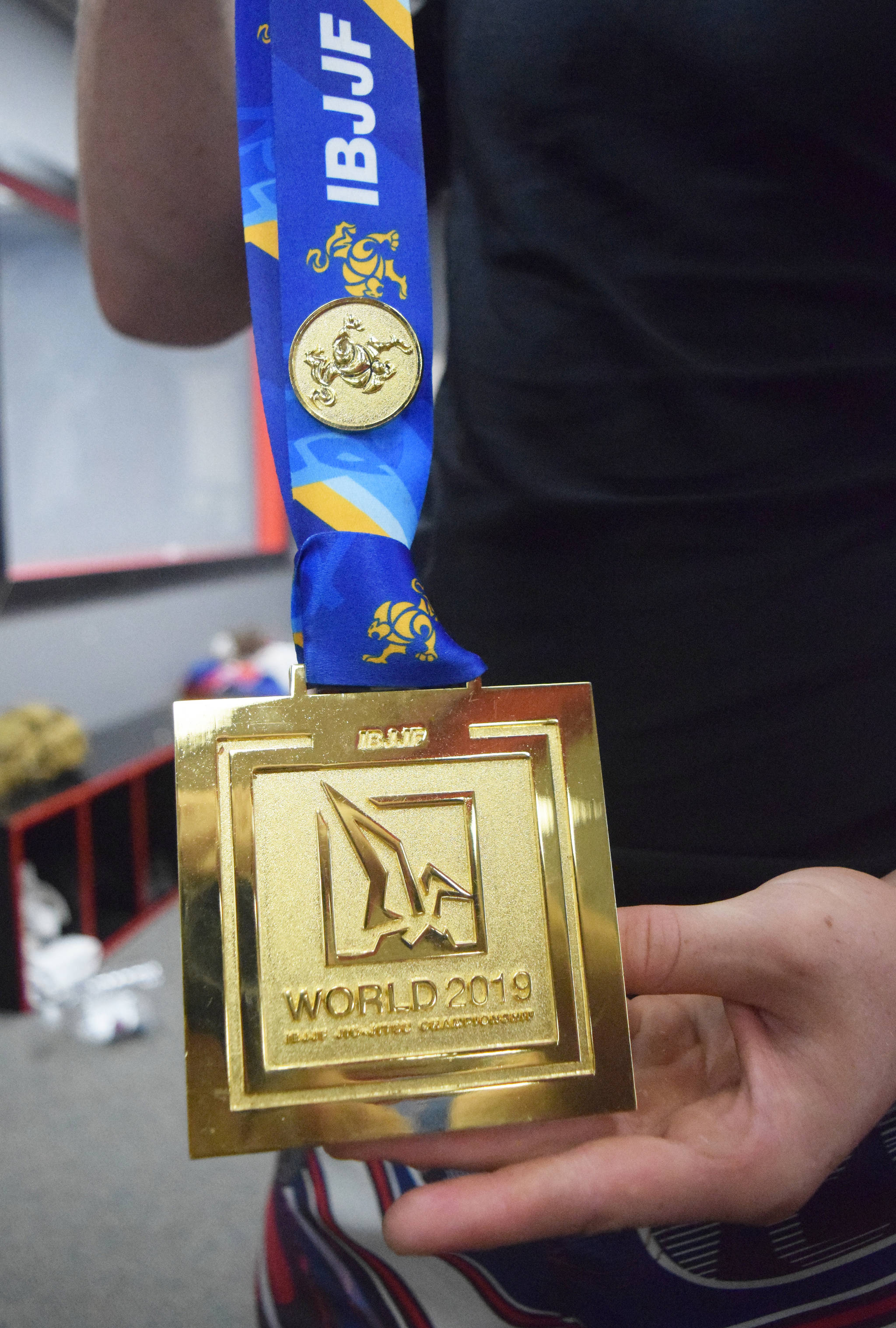 Soldotna's Sean Babitt shows off the first-place medal he won at the IBJJF World Championships June 1 in Long Beach, California. (Photo by Joey Klecka/Peninsula Clarion)