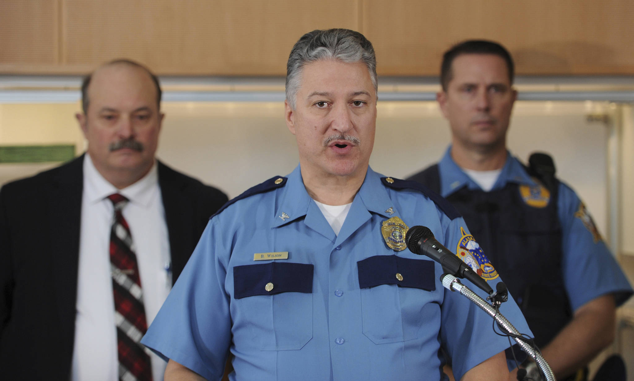 Alaska State Troopers Director Col. Barry Wilson, center, is flanked by Cold Case Investigator Randy McPherron, left, and Lt. Mike Ingram during the announcement on Tuesday, Sept. 3, 2019, in Anchorage, Alaska, that Oregon resident Donald F. McQuade, 62, has been arrested and charged with murdering teenager Shelley Connolly in a 1978 cold case. (Bill Roth/Anchorage Daily News via AP)