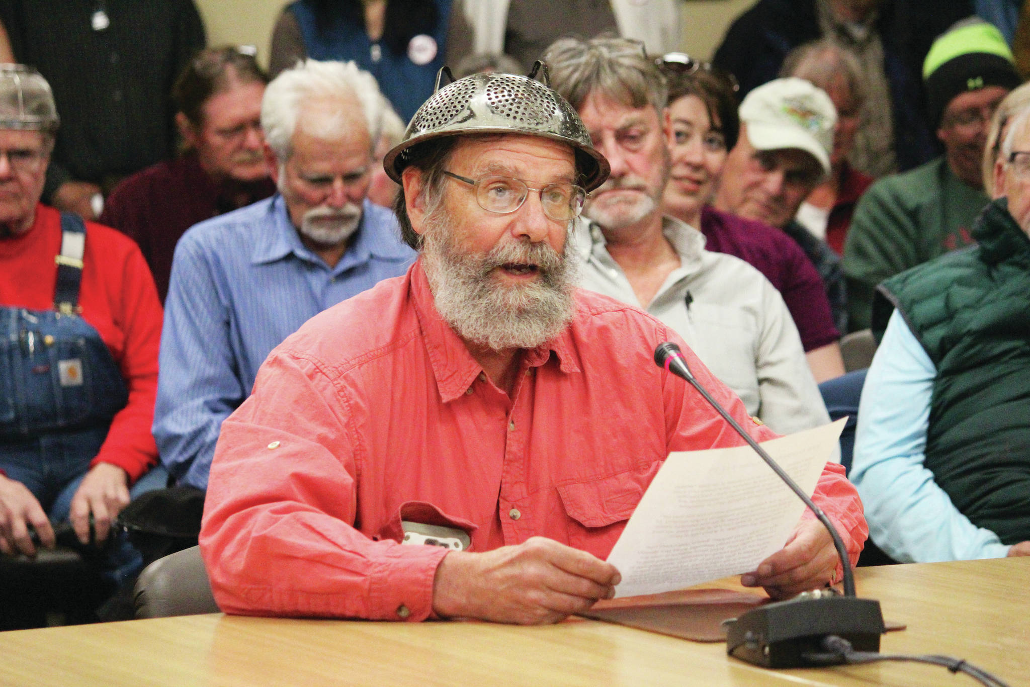 Megan Pacer/Homer News                                 Frtiz Creek area resident Barrett Fletcher gives the invocation before a Tuesday Kenai Peninsula Borough Assembly meeting as a representative of the Church of the Flying Spaghetti Monster at Homer City Hall.
