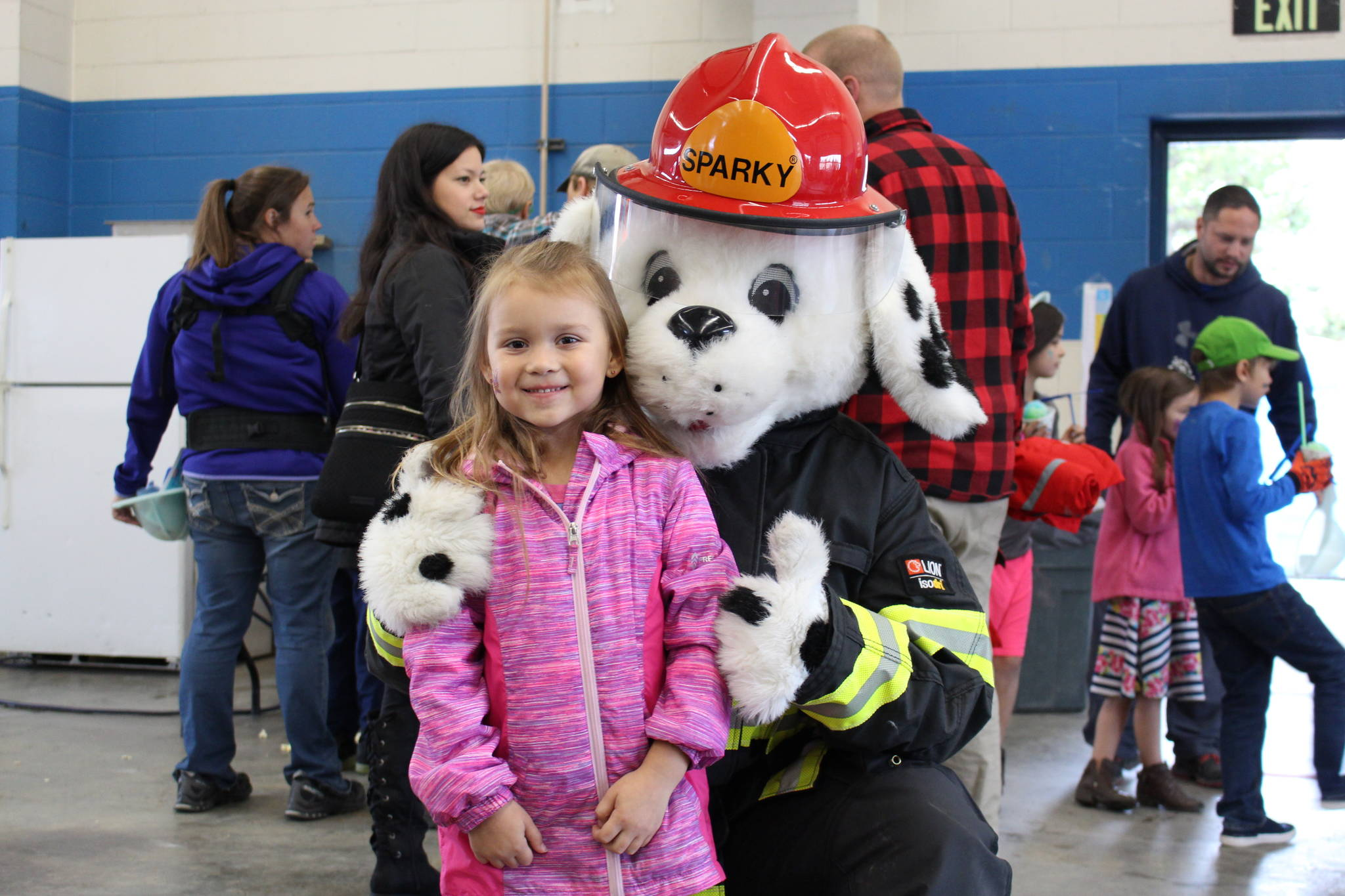 Journie Hoskins-Brendible poses with Sparky the Fire Dog during the Central Emergency Services Open House at Fire Station 1 in Soldotna, Alaska on Sept. 28, 2019. (Photo by Brian Mazurek/Peninsula Clarion)