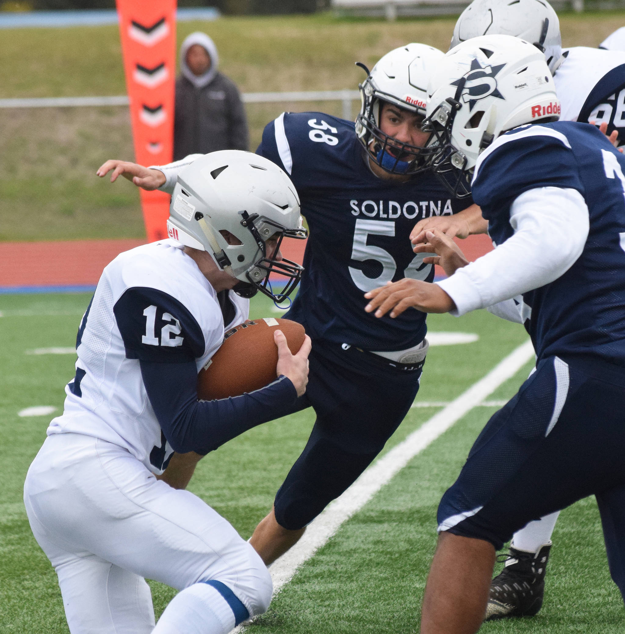 Soldotna's Zack Ziegler rushes Eagle River quarterback Nathaniel Guderian, Saturday, Sept. 28, 2019, against Eagle River at Justin Maile Field in Soldotna. (Photo by Joey Klecka/Peninsula Clarion)