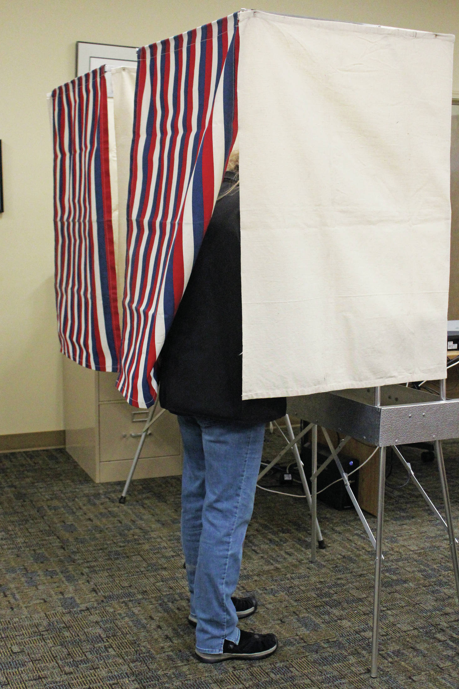 A Homer city resident casts their vote in the Tuesday, Oct. 1, 2019 municipal election at Homer City Hall in Homer, Alaska. (Photo by Megan Pacer/Homer News)