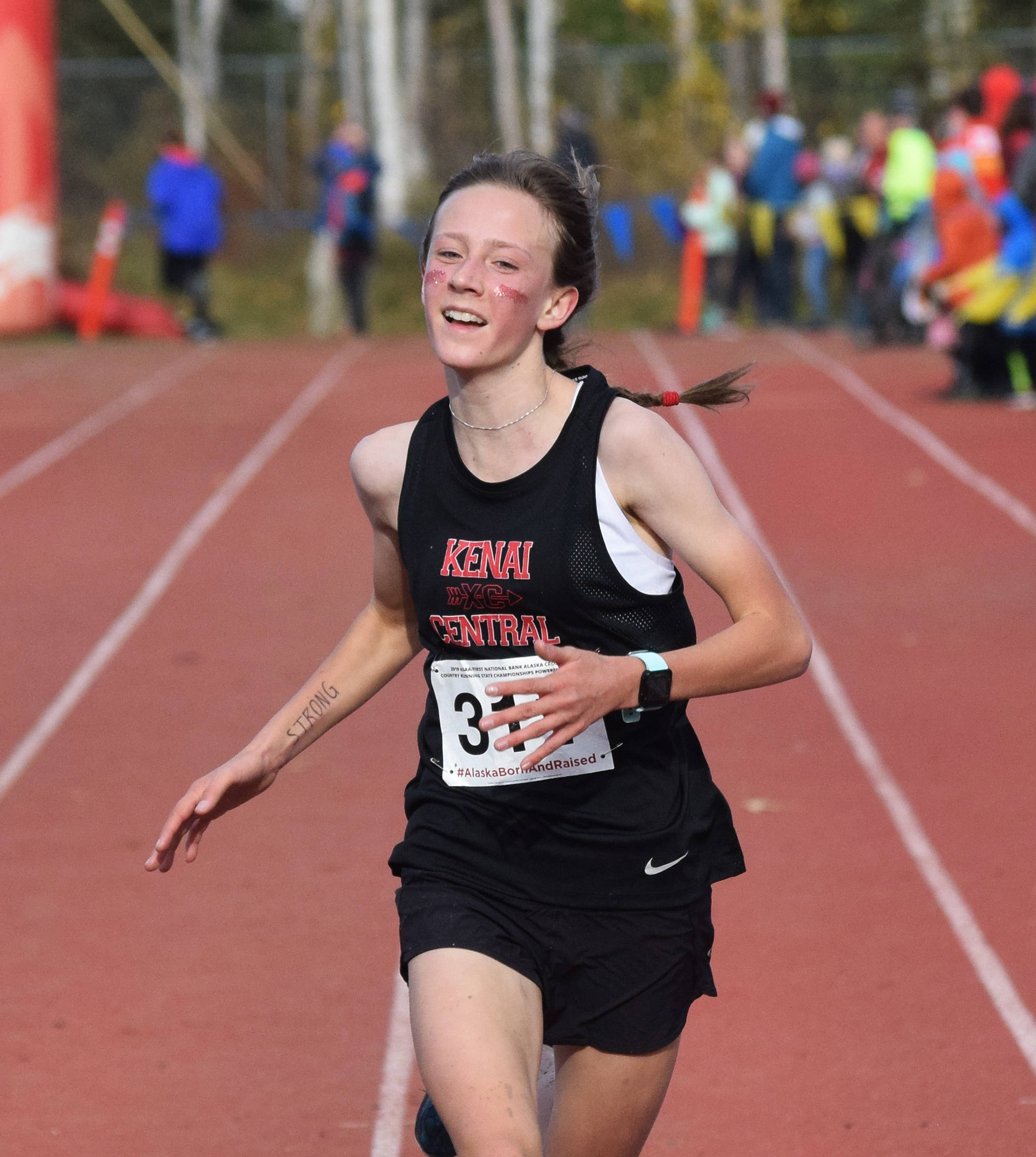 Kenai's Jayna Boonstra crosses the finish of the Div. II girls state cross-country championships Saturday, Oct. 5, 2019, on the Bartlett High trails in Anchorage, Alaska. (Photo by Joey Klecka/Peninsula Clarion)