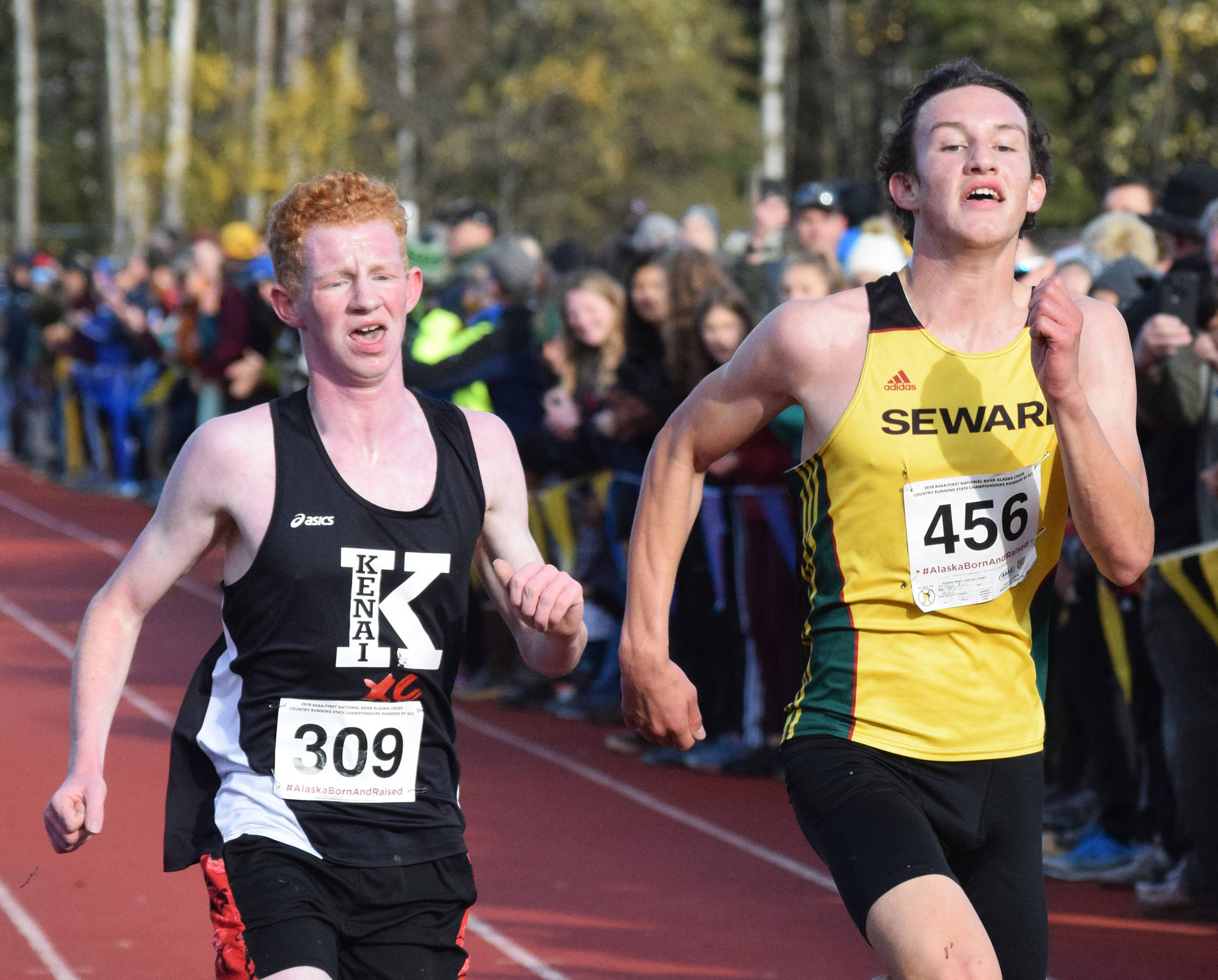 Kenai's Joe Hamilton (left) and Seward's Bjorn Nilsson race for 13th-place in the Div. II boys state cross-country championships Saturday, Oct. 5, 2019, on the Bartlett High trails in Anchorage, Alaska. (Photo by Joey Klecka/Peninsula Clarion)