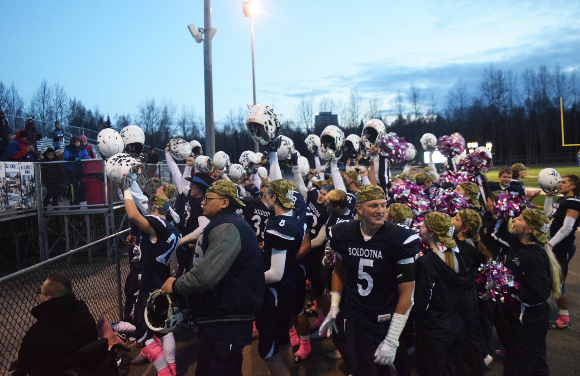 The Soldotna football team celebrates the victory over Lathrop, Saturday, Oct. 19, 2019, at the Div. II state football championship at Anchorage Football Stadium in Anchorage, Alaska. (Photo by Joey Klecka/Peninsula Clarion)
