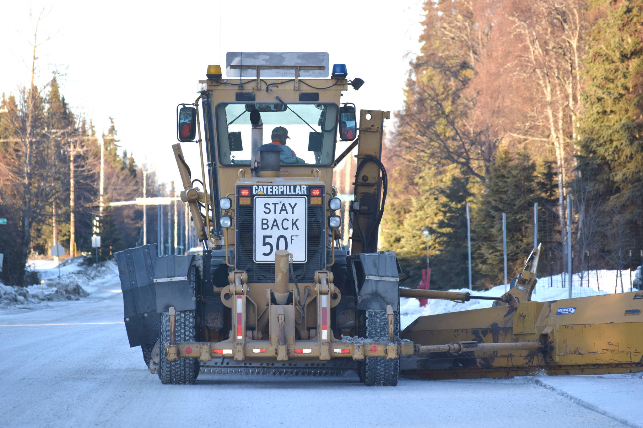 A contractor plows snow down Forest Drive in Kenai on Jan. 17, 2019. (Photo by Brian Mazurek/Peninsula Clarion)