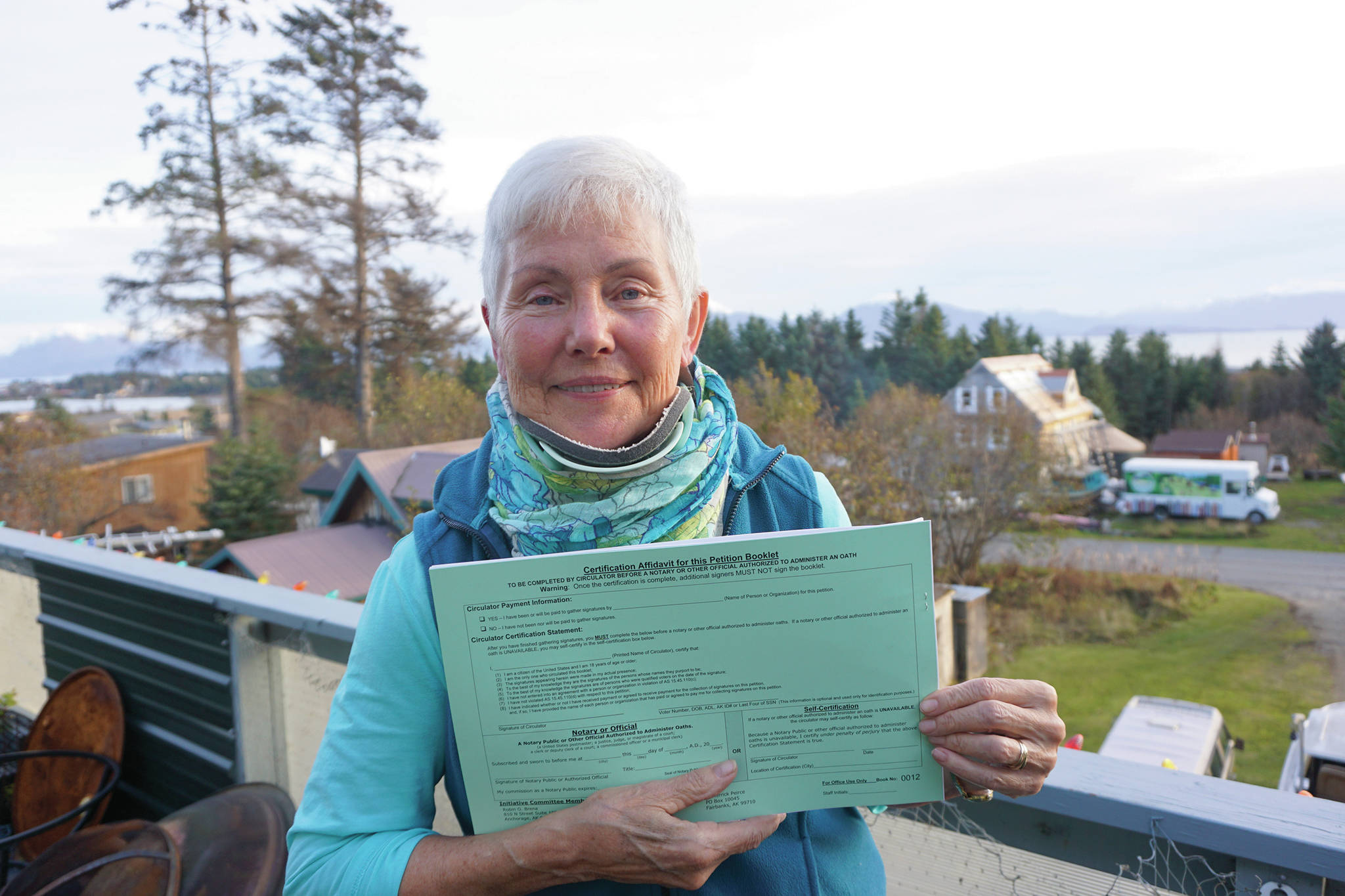 Michael Armstrong / Homer News                                 Fair Share Act sponsor Jane Angvik holds an initiative petition booklet she delivered to Homer on Oct. 25.