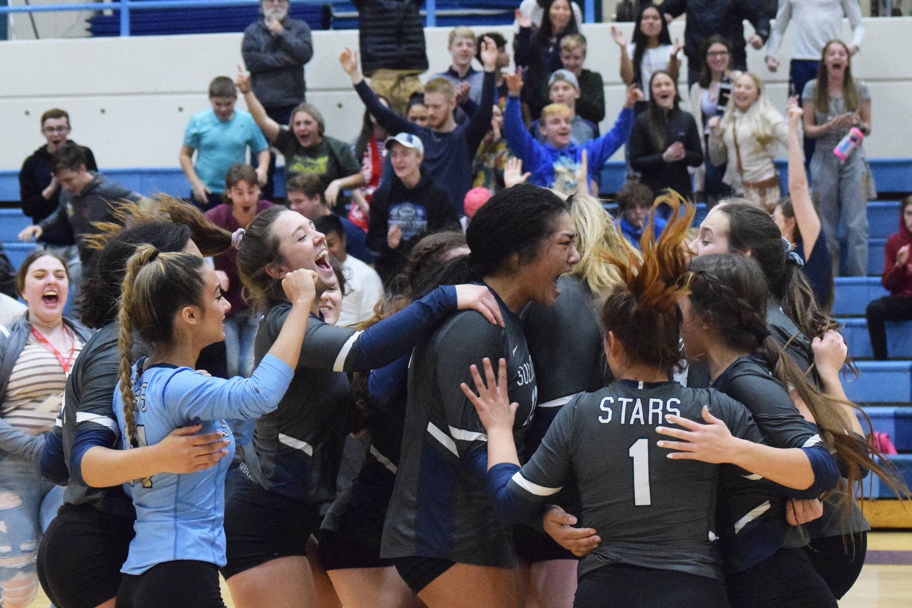 The Soldotna volleyball team celebrates on the floor after beating Wasilla Thursday, Nov. 7, 2019, at the Northern Lights Conference tournament at Soldotna High School in Soldotna, Alaska. (Photo by Joey Klecka/Peninsula Clarion)
