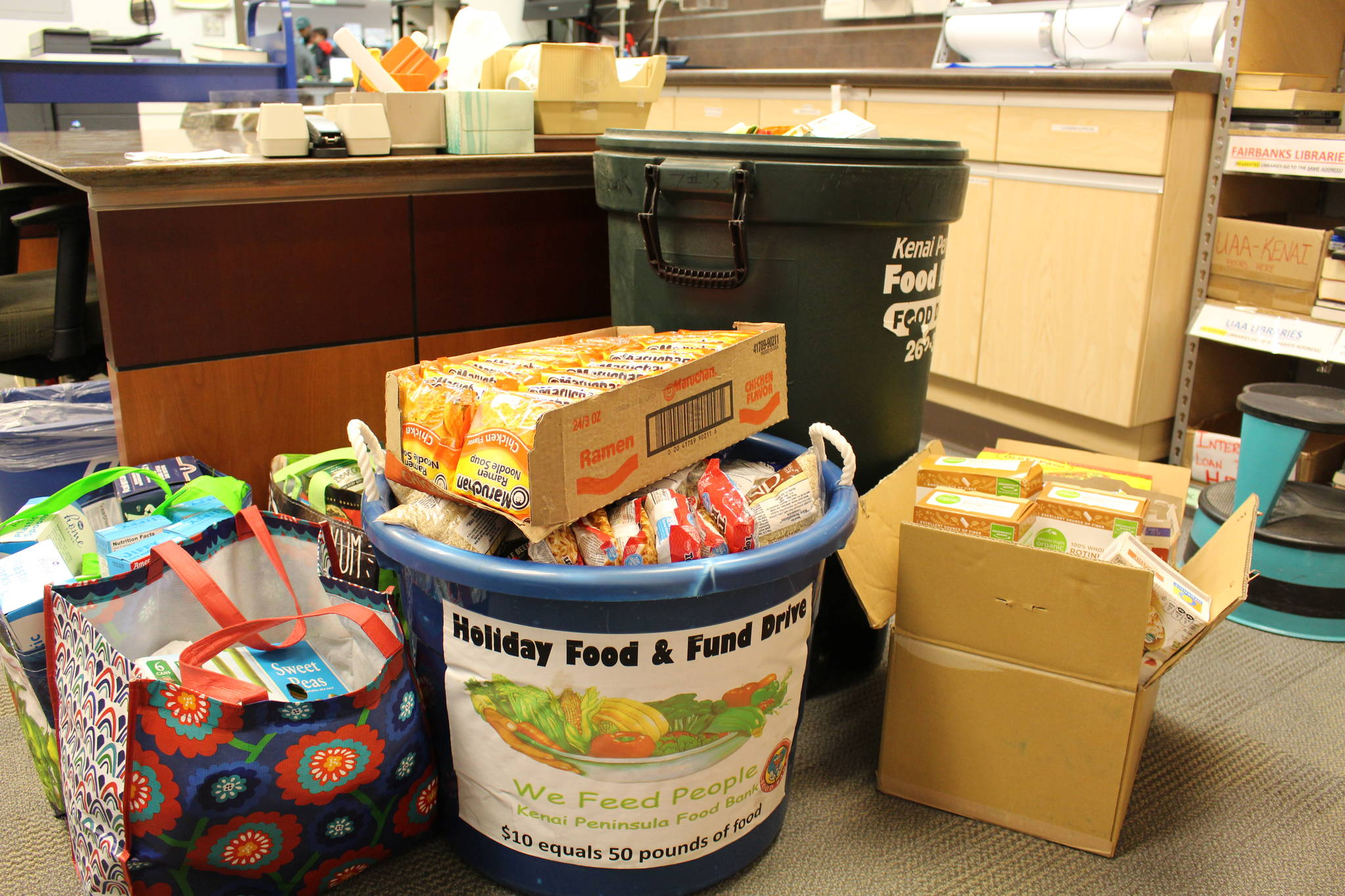 Food to be donated to the Kenai Peninsula Food Bank can be seen here at the Soldotna Public Library on Sept. 20, 2019. (Photo by Brian Mazurek/Peninsula Clarion)