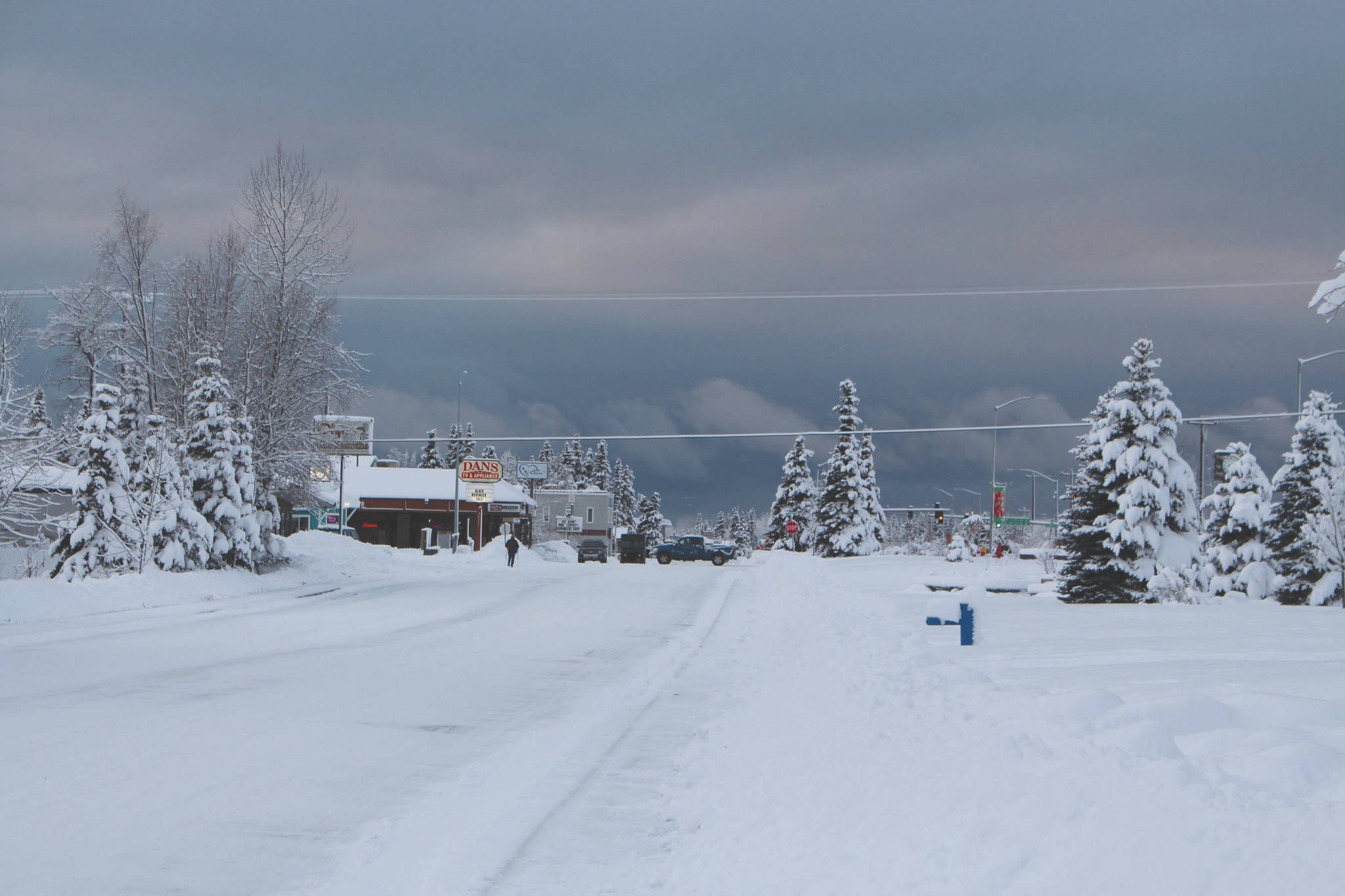 Frontage Road in Kenai is covered in compact snow.