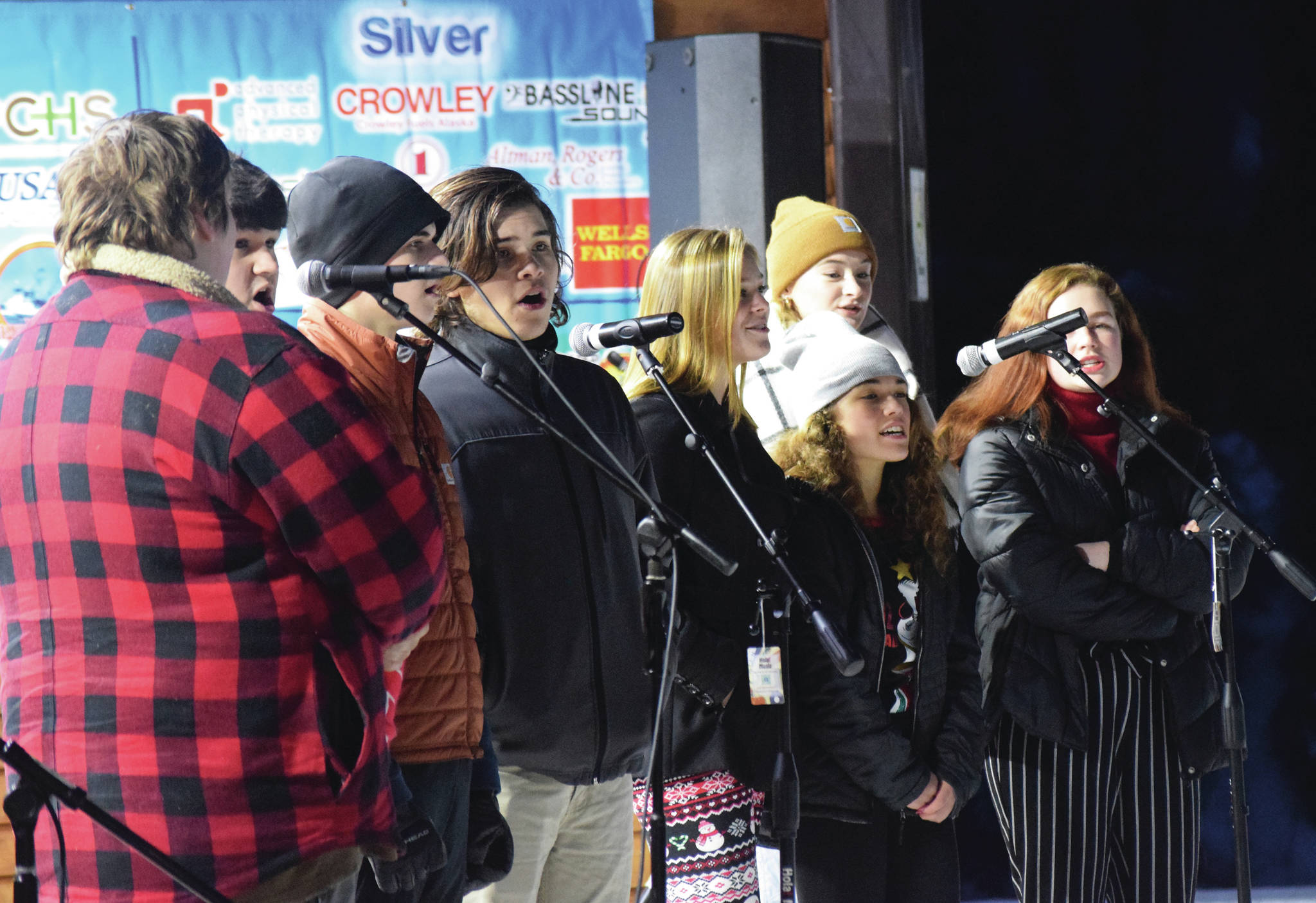 The Class Act Drama Troupe entertains the crowd with singing Saturday, Dec. 7, 2019, at the Christmas in the Park celebration at Soldotnat Creek Park in Soldotna, Alaska. (Photo by Joey Klecka/Peninsula Clarion)