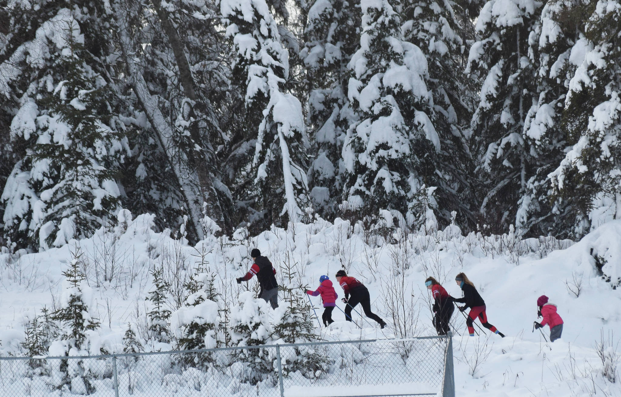 A group of skiers make their way along a trail behind Skyview High School, Saturday, Dec. 7, 2019, at the Black Stone Axe Ridge Warm Up Rally at the Tsalteshi Trails in Soldotna, Alaska. (Photo by Joey Klecka/Peninsula Clarion)