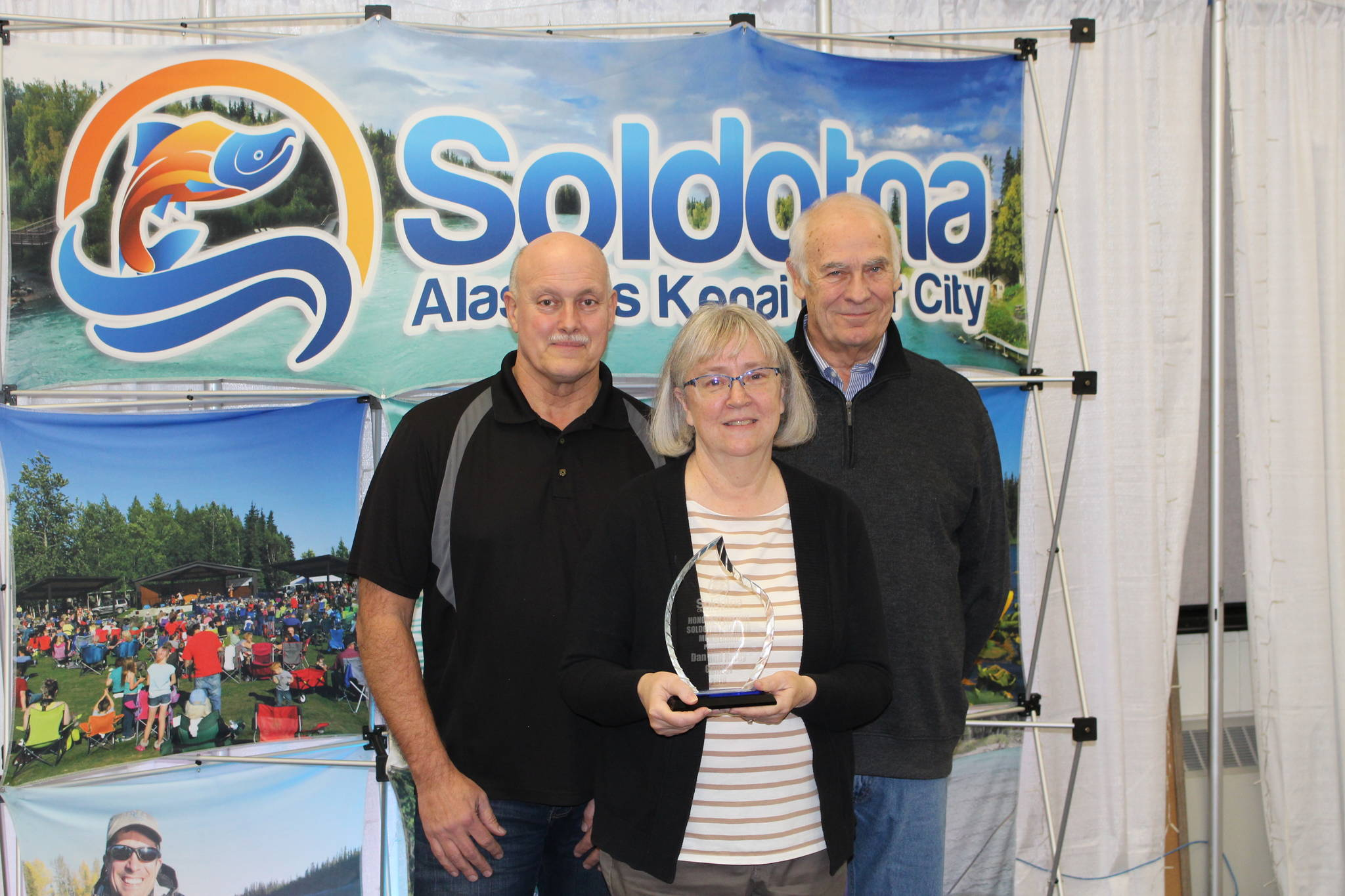 Dan Gensel, Kathy Gensel and Chamber President Jim Stogsdill smile for the camera at the Soldotna Chamber of Commerce Awards Luncheon at the Soldotna Regional Sports Complex on Dec. 11, 2019. (Photo by Brian Mazurek/Peninsula Clarion)
