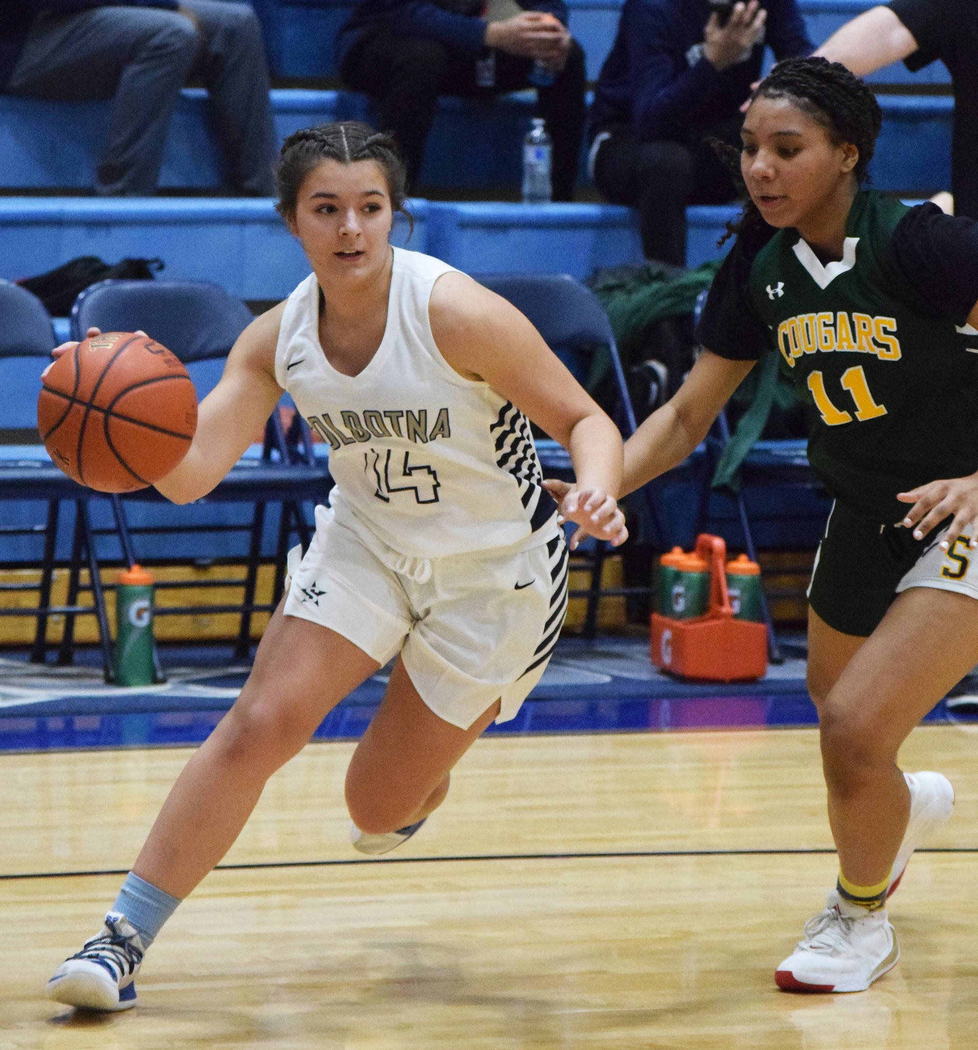 Soldotna's Mikayla Leadens races around Service defender Neolani Quitugua-Banks, Friday, Dec. 20, 2019, at the Powerade/Al Howard Tip-Off tournament at Soldotna High School. (Photo by Joey Klecka/Peninsula Clarion)
