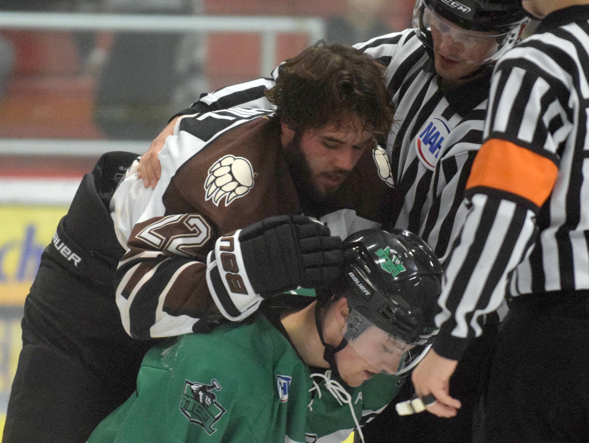Kenai River Brown Bears defenseman Connor Scahill is involved in a brief scuffle with Jordan Gonzalez of the Chippewa (Wisconsin) Steel on Oct. 5, 2018, at the Soldotna Regional Sports Complex. (Photo by Jeff Helminiak/Peninsula Clarion)