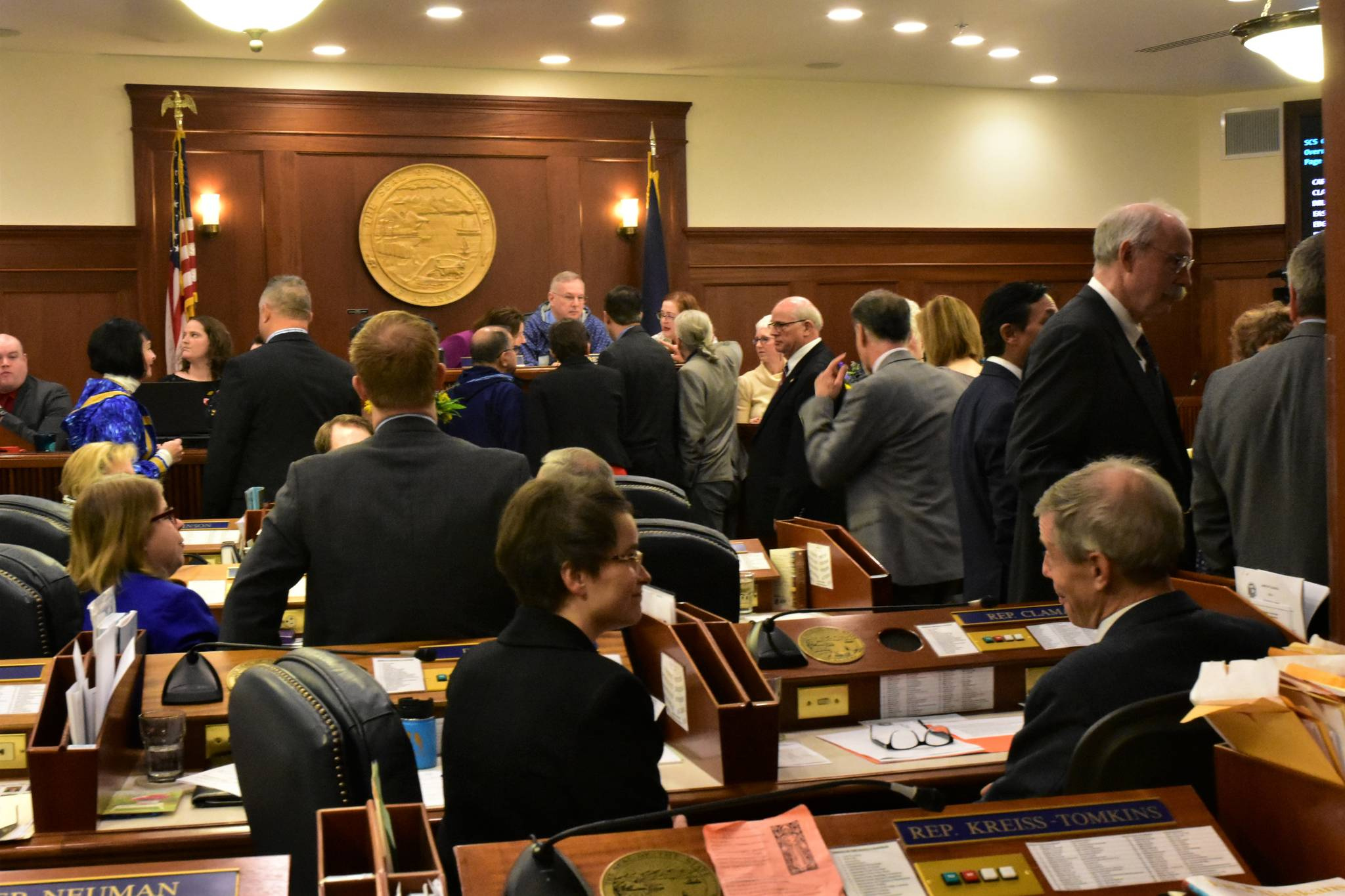 photos by Peter Segall | Juneau Empire                                 Representatives and senators talk during an at ease during a joint session on Friday.