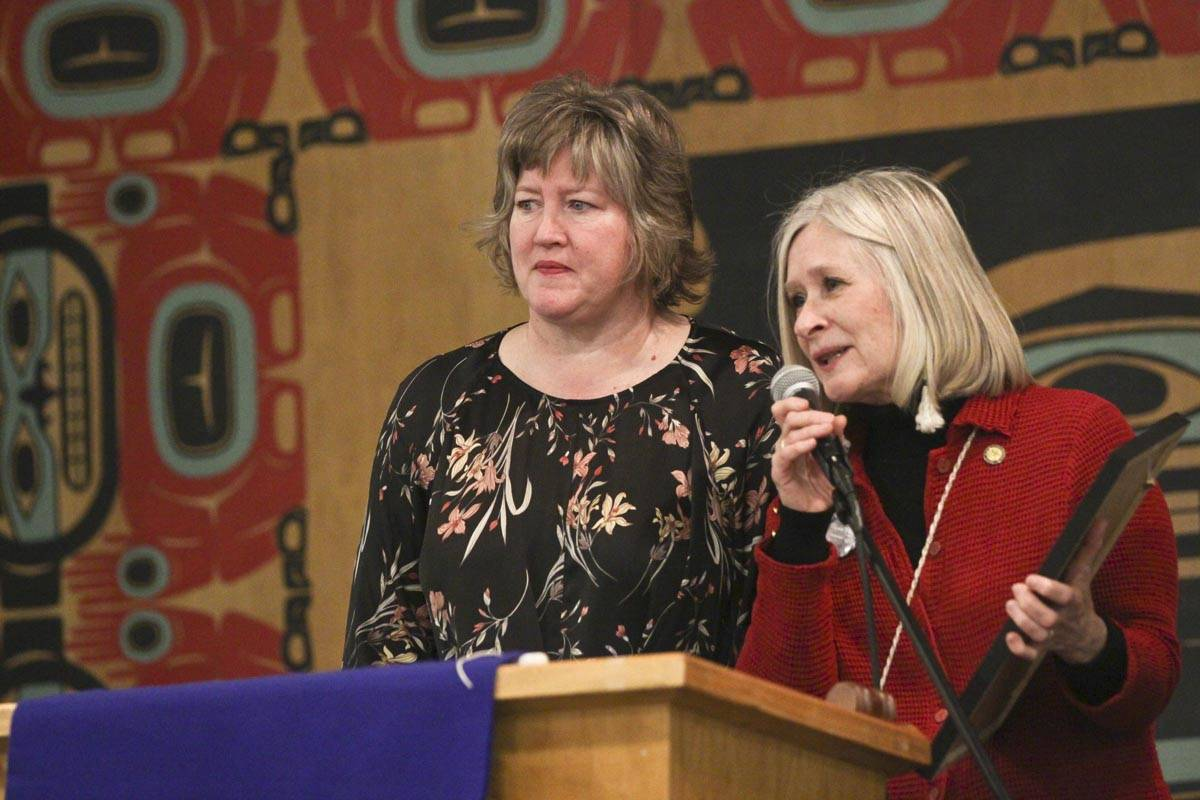 Rep. Sara Hannan and Rep. Andi Story address the crowd during the Elizabeth Peratrovich Day celebration at the Tlingit and Haida Community Council Sunday. (Michael S. Lockett | Juneau Empire)