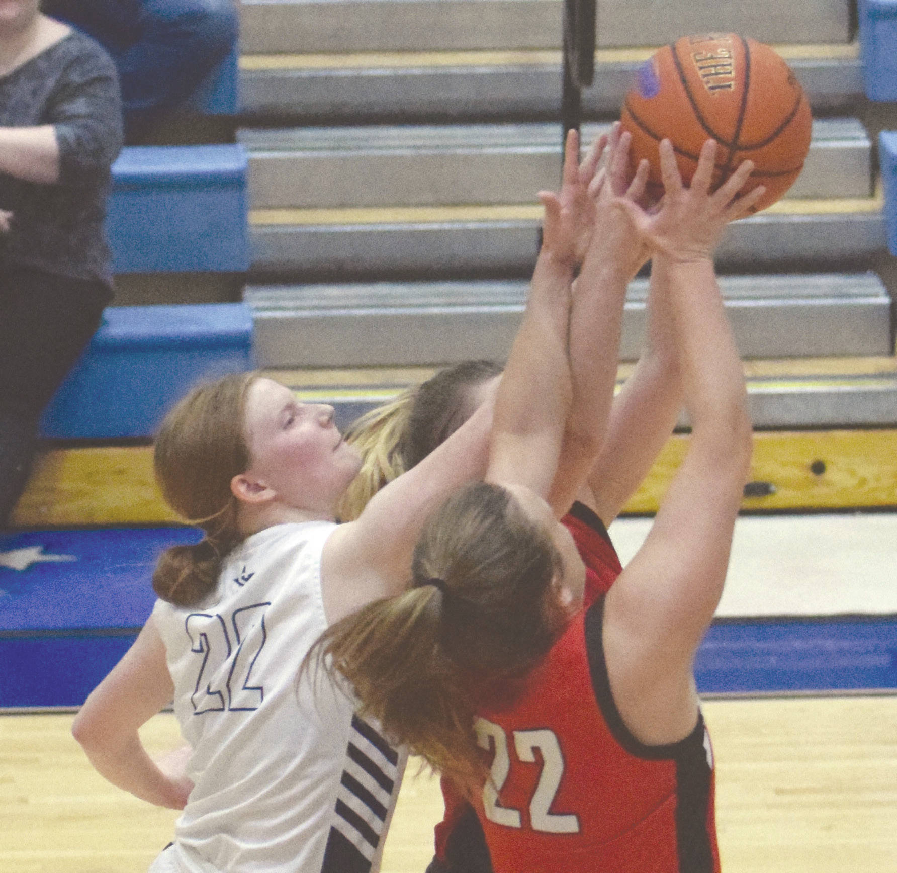 Soldotna's Kianna Holland battles with Kenai's Jaiden Streiff for the rebound Saturday, Feb. 29, 2020, at Soldotna High School in Soldotna, Alaska. (Photo by Jeff Helminiak/Peninsula Clarion)