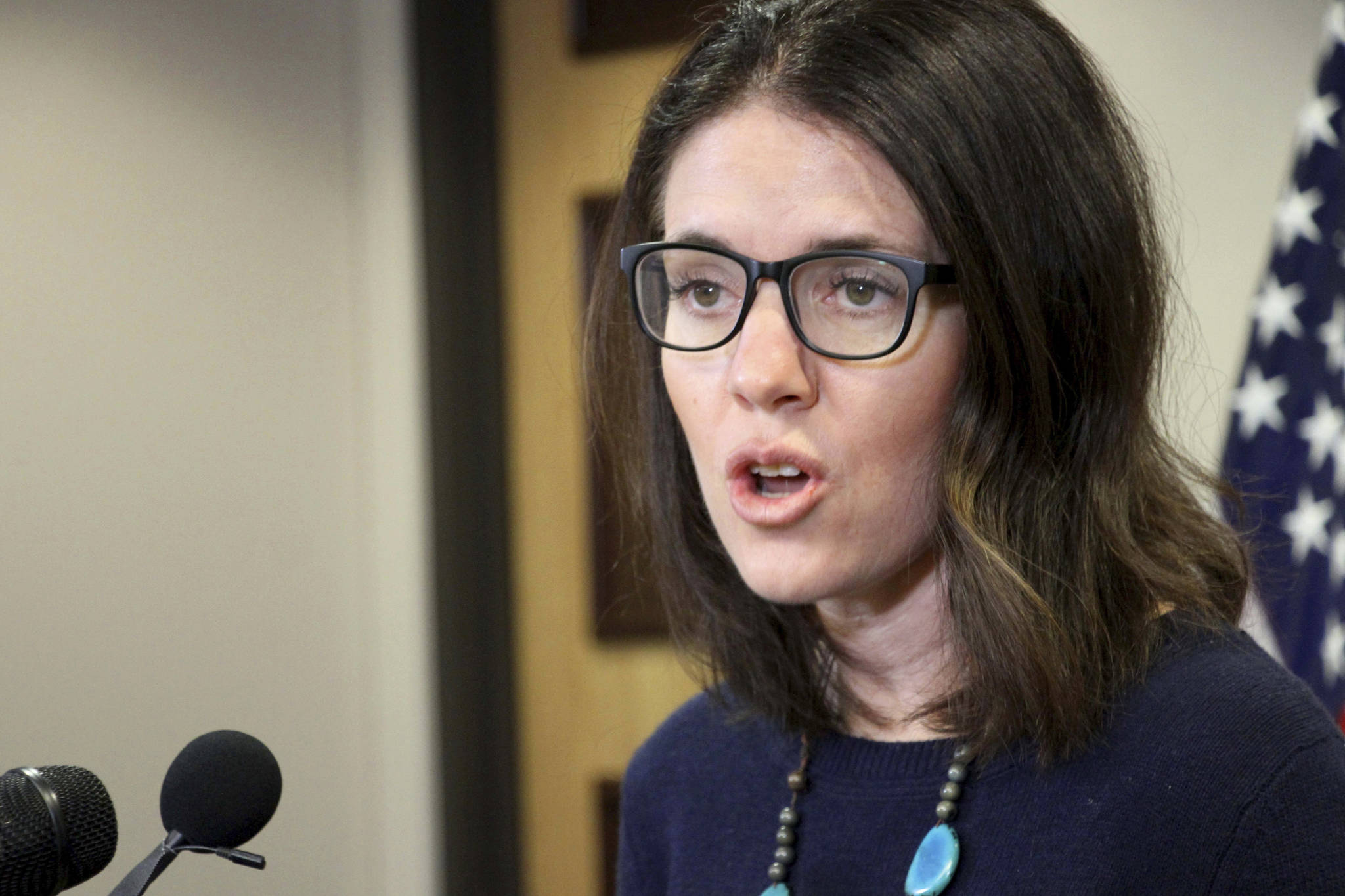 Dr. Anne Zink, the chief medical officer for the state of Alaska, addresses reporters at a news conference Monday in Anchorage. (AP Photo/Mark Thiessen)