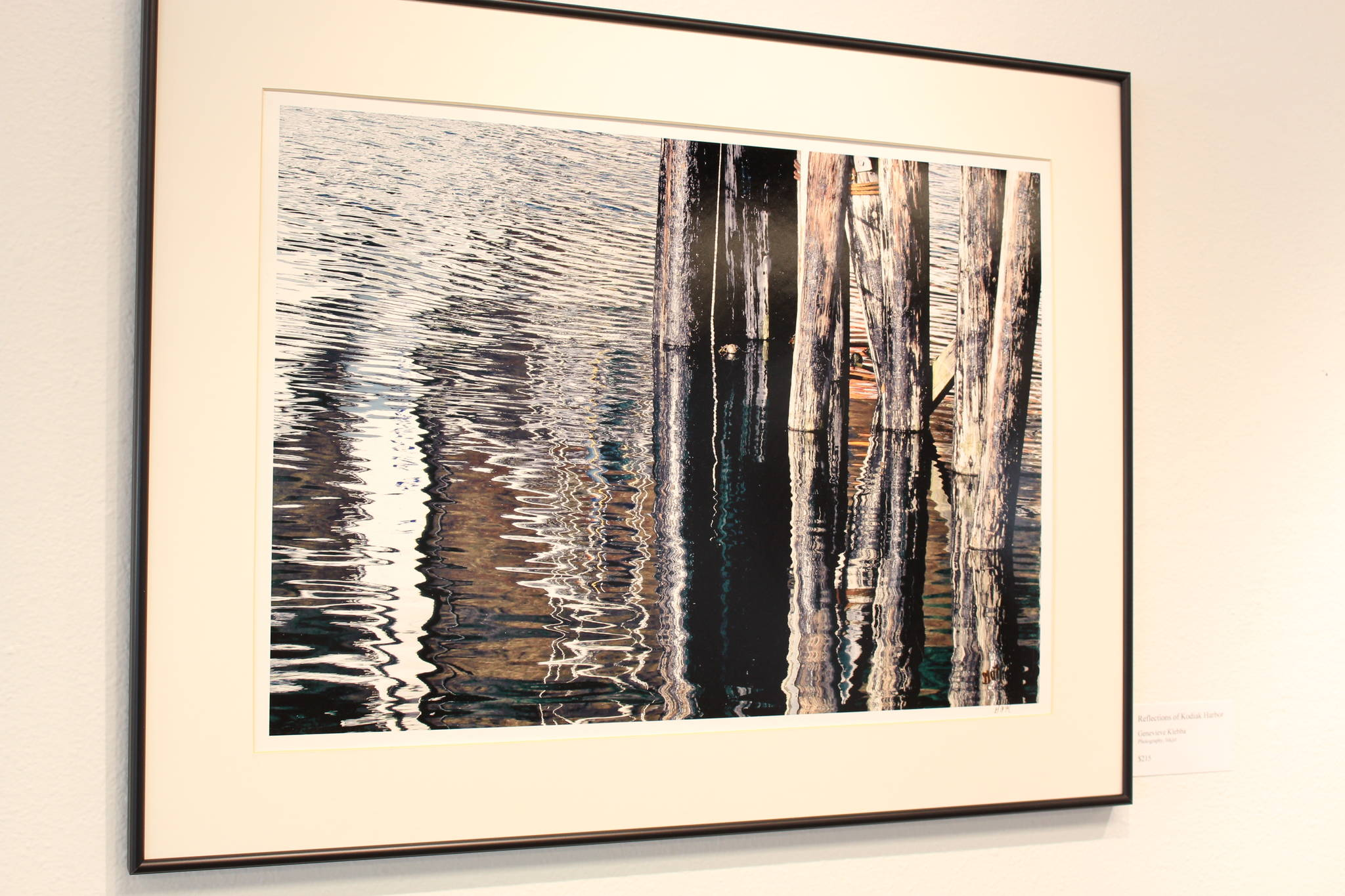 Reflections of Kodiak Harbor, a piece by local photographer Genevieve Klebba, is seen here on display at the Kenai Fine Art Center in Kenai, Alaska on March 18, 2020. (Photo by Brian Mazurek/Peninsula Clarion)