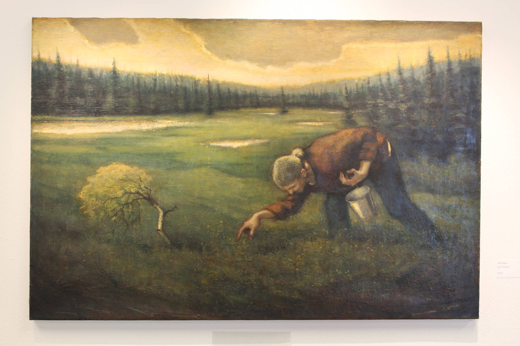 "Photos by Brian Mazurek / Peninsula Clarion                                 ""The Picker,"" an oil painting by local artist Alex Rydinski, is on display at the Kenai Fine Art Center in Kenai on Wednesday. Rydinski's painting was selected as the Juror's Choice for the center's Biannual Juried Show."