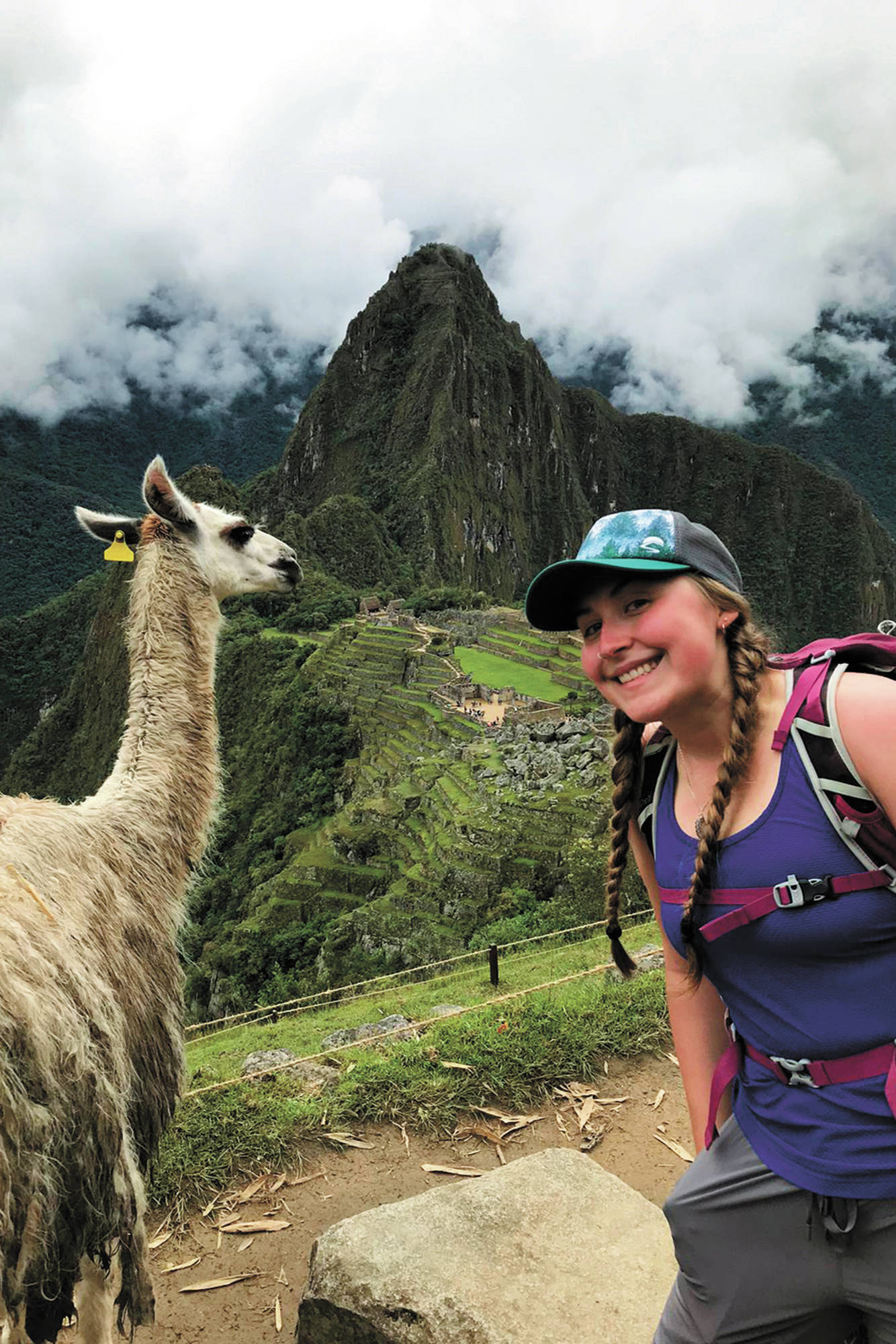 Brenna McCarron, a Homer High School graduate stuck in Peru after the country closed its borders to stem the spread of the novel coronavirus, enjoys the sights at Machu Picchu, Peru. She is one of about 19 Alaskans stranded in the country. (Photo courtesy Brenna McCarron)