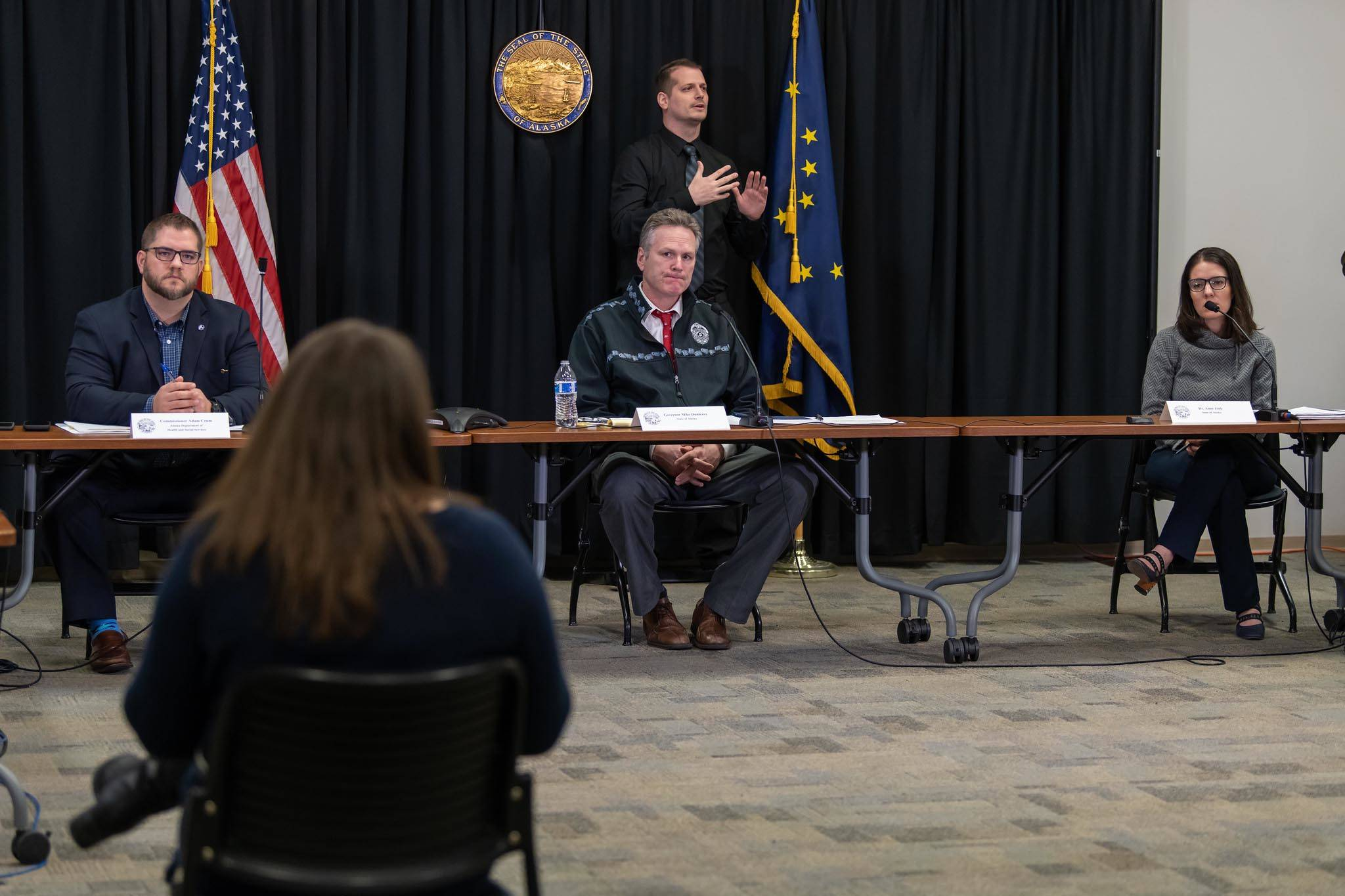 From left: DHSS Commissioner Adam Crum, Gov. Mike Dunleavy, Chief Medical Officer Dr. Anne Zink participate in a press conference on the COVID-19 pandemic on Wednesday, March 25, 2020. (Photo courtesy Office of Gov. Mike Dunleavy)