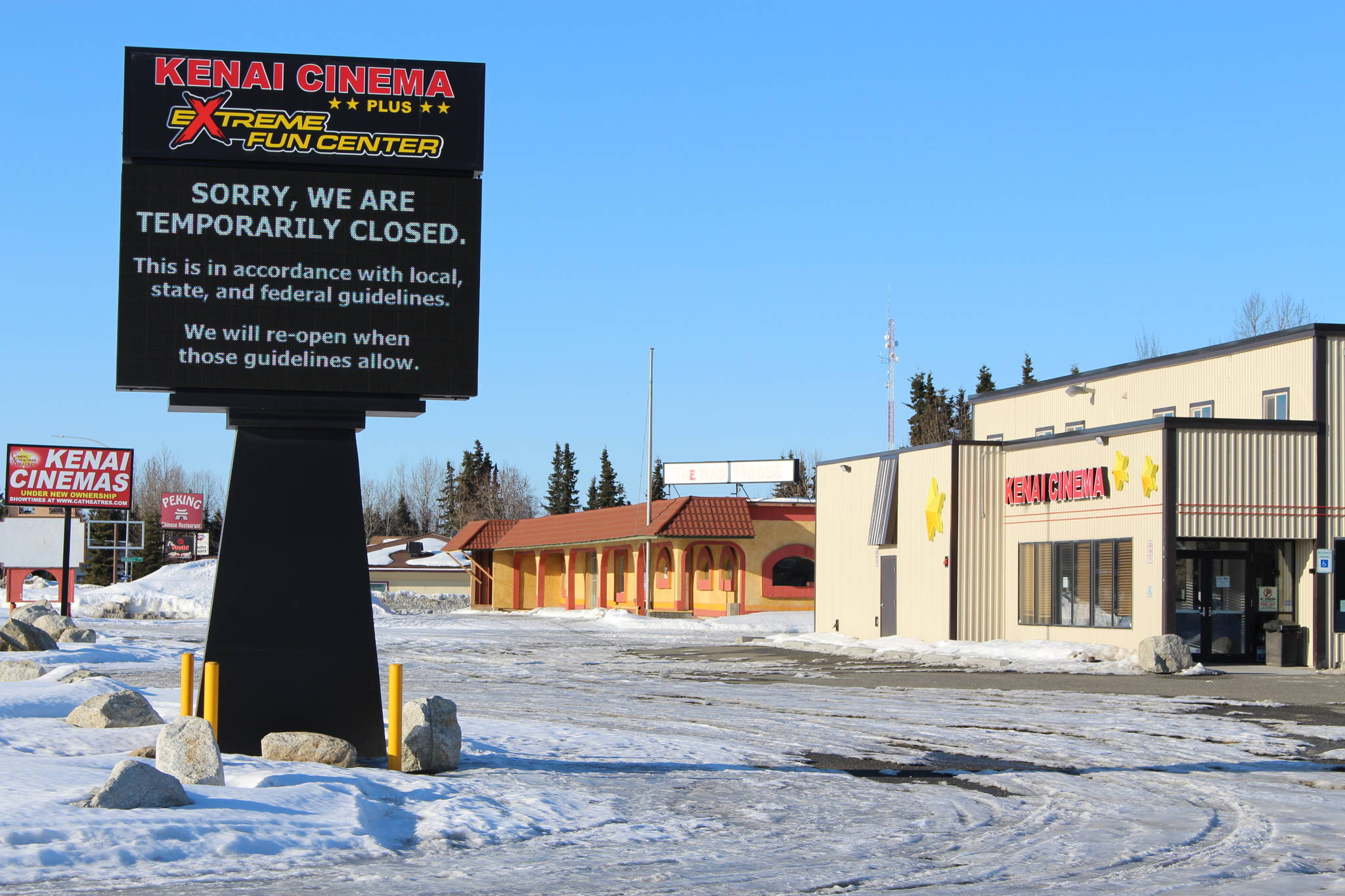 The sign outside of the Kenai Cinema and Extreme Fun Center can be seen here in Kenai, Alaska, on March 28, 2020. (Photo by Brian Mazurek/Peninsula Clarion)