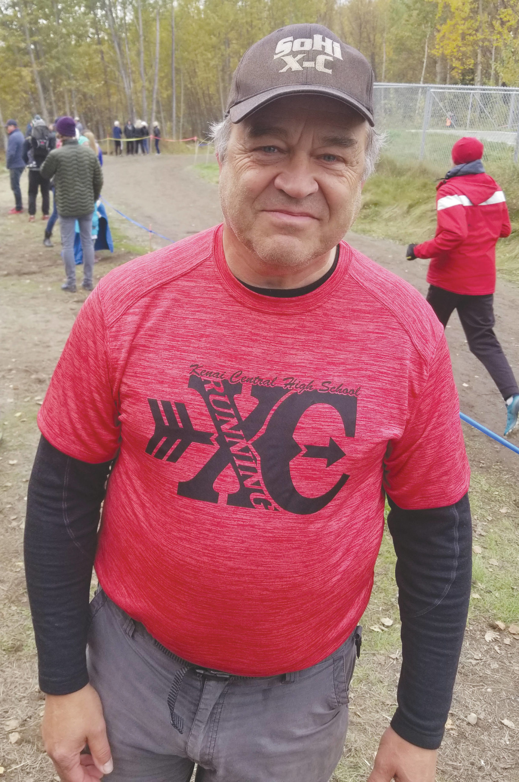 During the 2019 cross-country season, Soldotna High School coach Ted McKenney put on Kenai Central gear to support the Kardinals in the small-schools race before switching back to SoHi gear for the big-schools race. (Photo by Crystal McKenney)